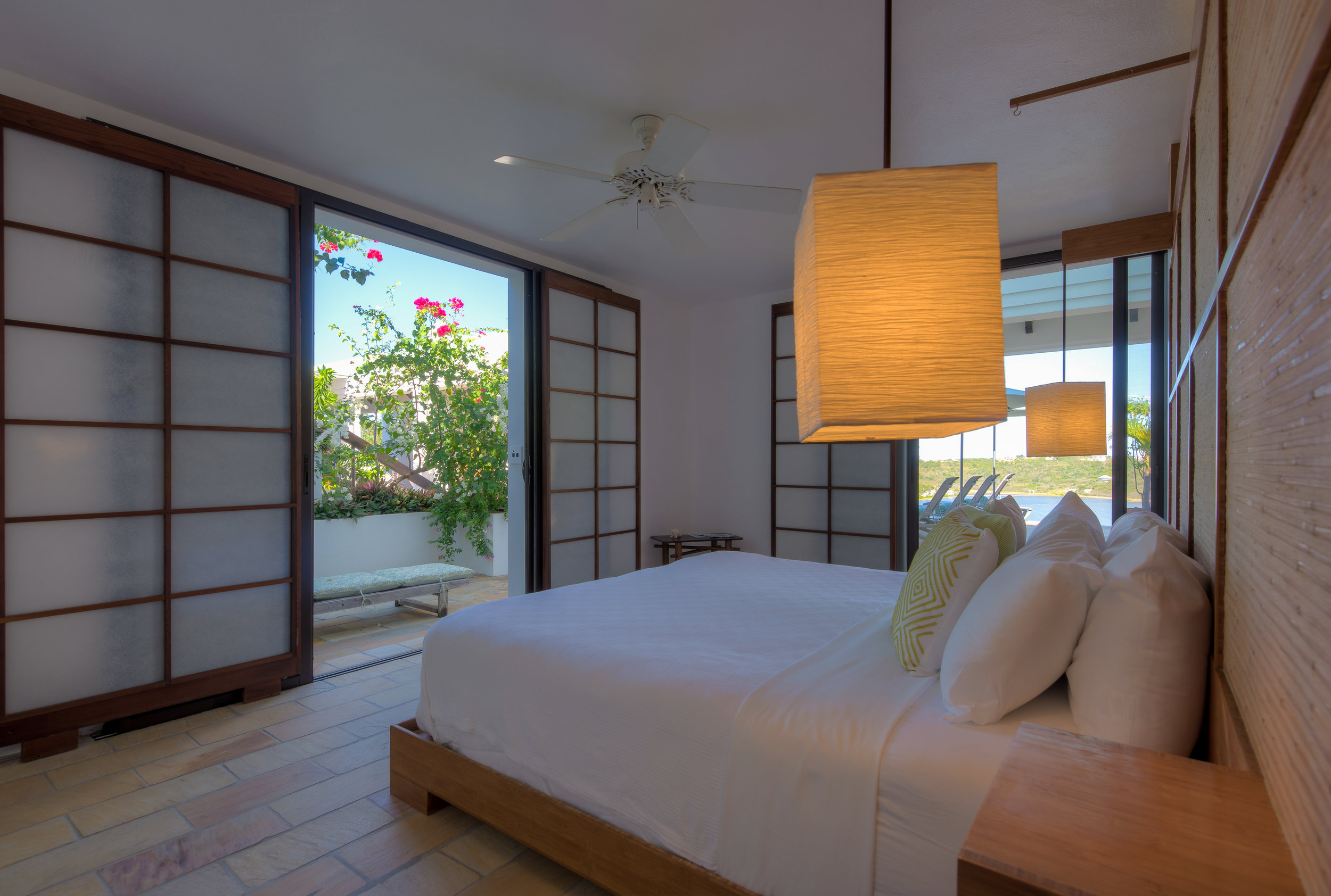 Bedroom #2 - Sandy Ground - Bedroom shot with terrace and pool view.jpg
