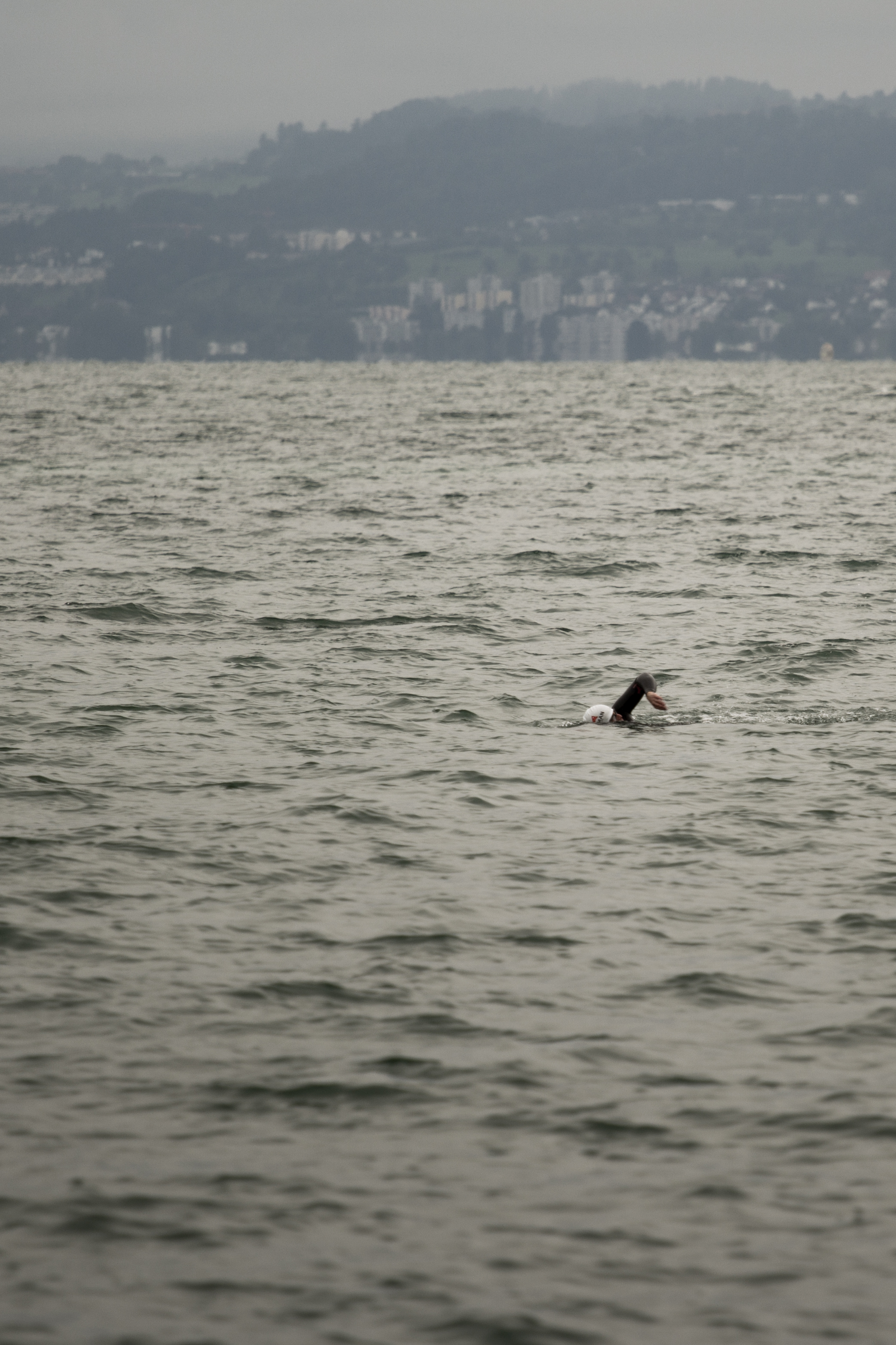 Ironman Zurich, 2014. Athletes from around the world are training in cold open waters before the race.