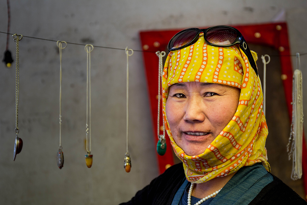 A peaceful home for refugees  After her parents fled from Tibet in 1970, Tashi Sinon was born in Leh. Ladakh is at the center of a war waged by three governments - India, China and Pakistan. Yet, things here are peaceful. Tashi reflects that emotion well; she is stylish, makes her own jewelery and speaks fluent English. Photo: Trivik Verma