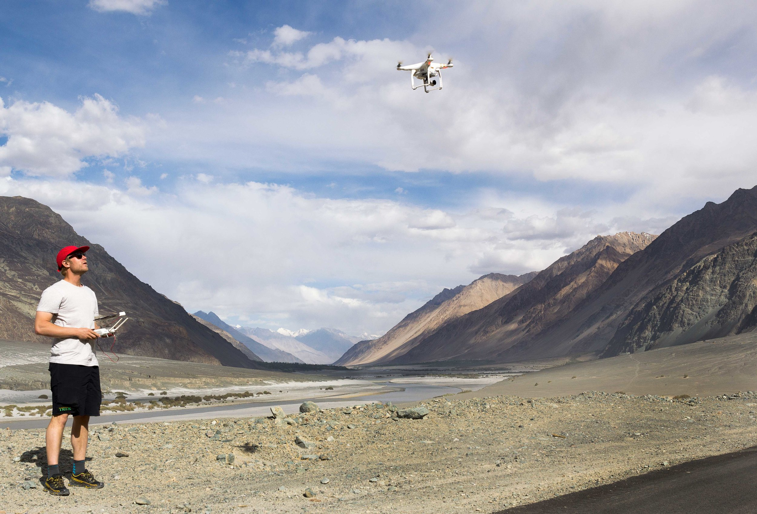 Tyler Wilkinson-Ray setting up the drone close to an airstrip where flying drones is strictly prohibited. This area is merely 40 kms from the border with Pakistan, but runners have been taking this path to deliver mail for decades.