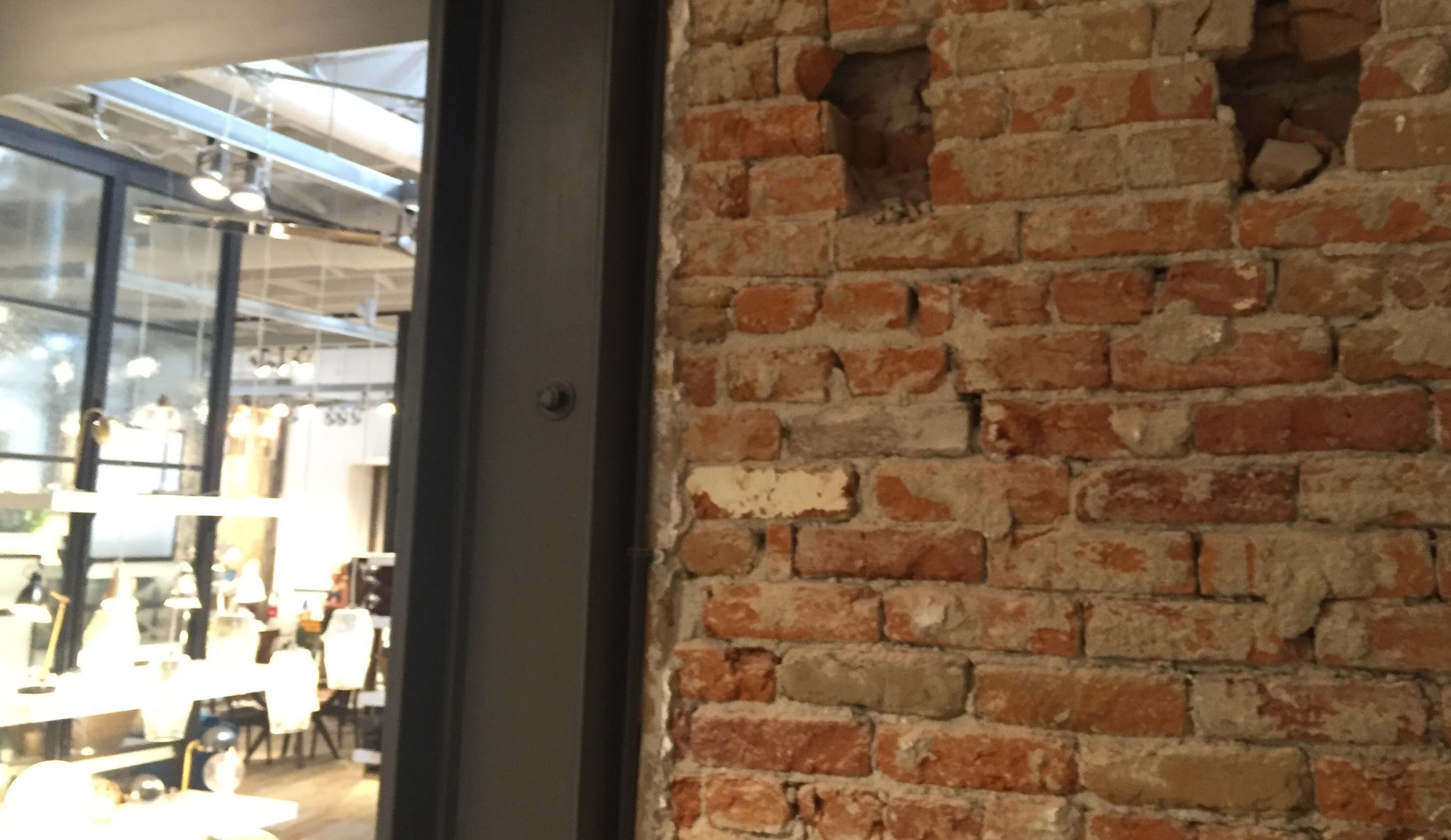 Requisite exposed, worn brick