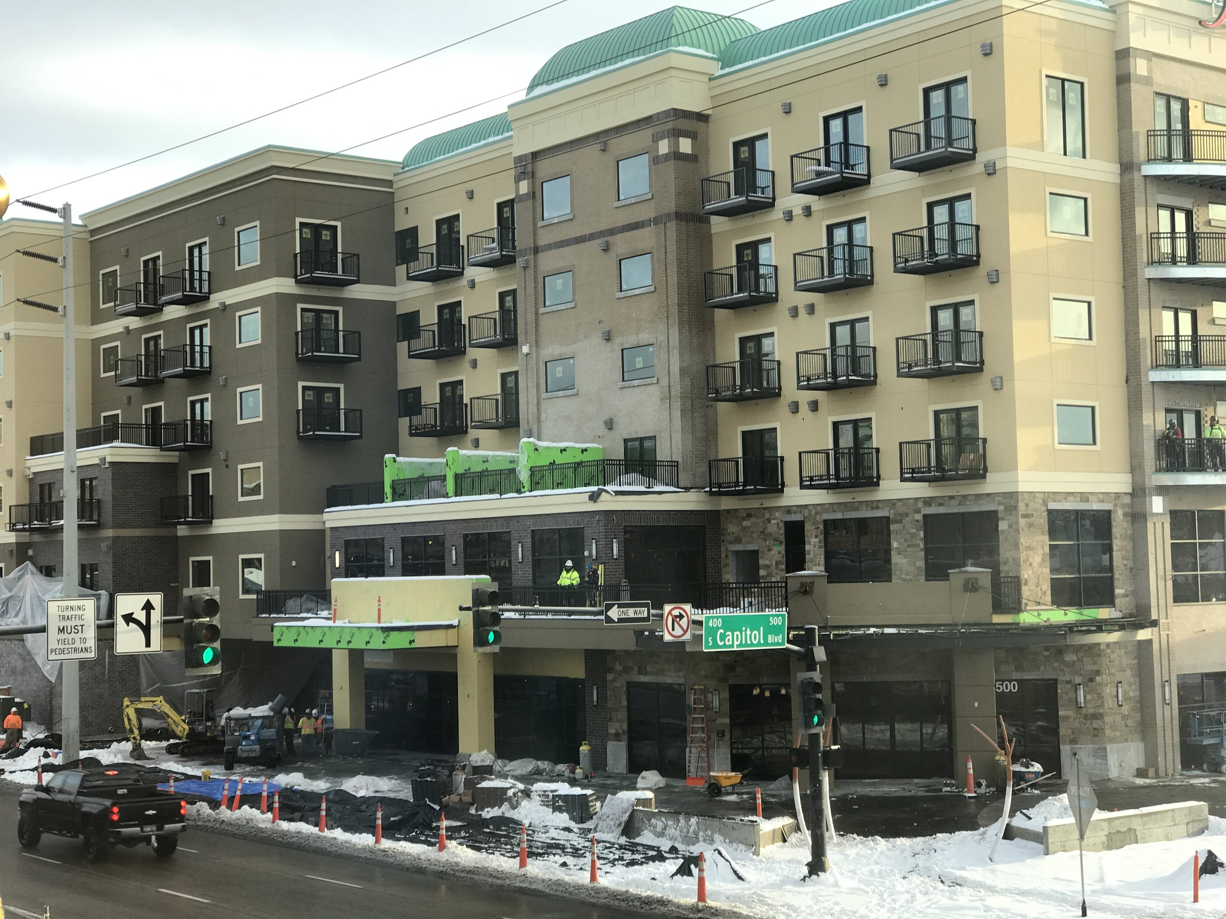 Inn at 500 Capitol on Tuesday 12/26. The Richards site is on the ground floor under the unfinished awning with green construction material visible