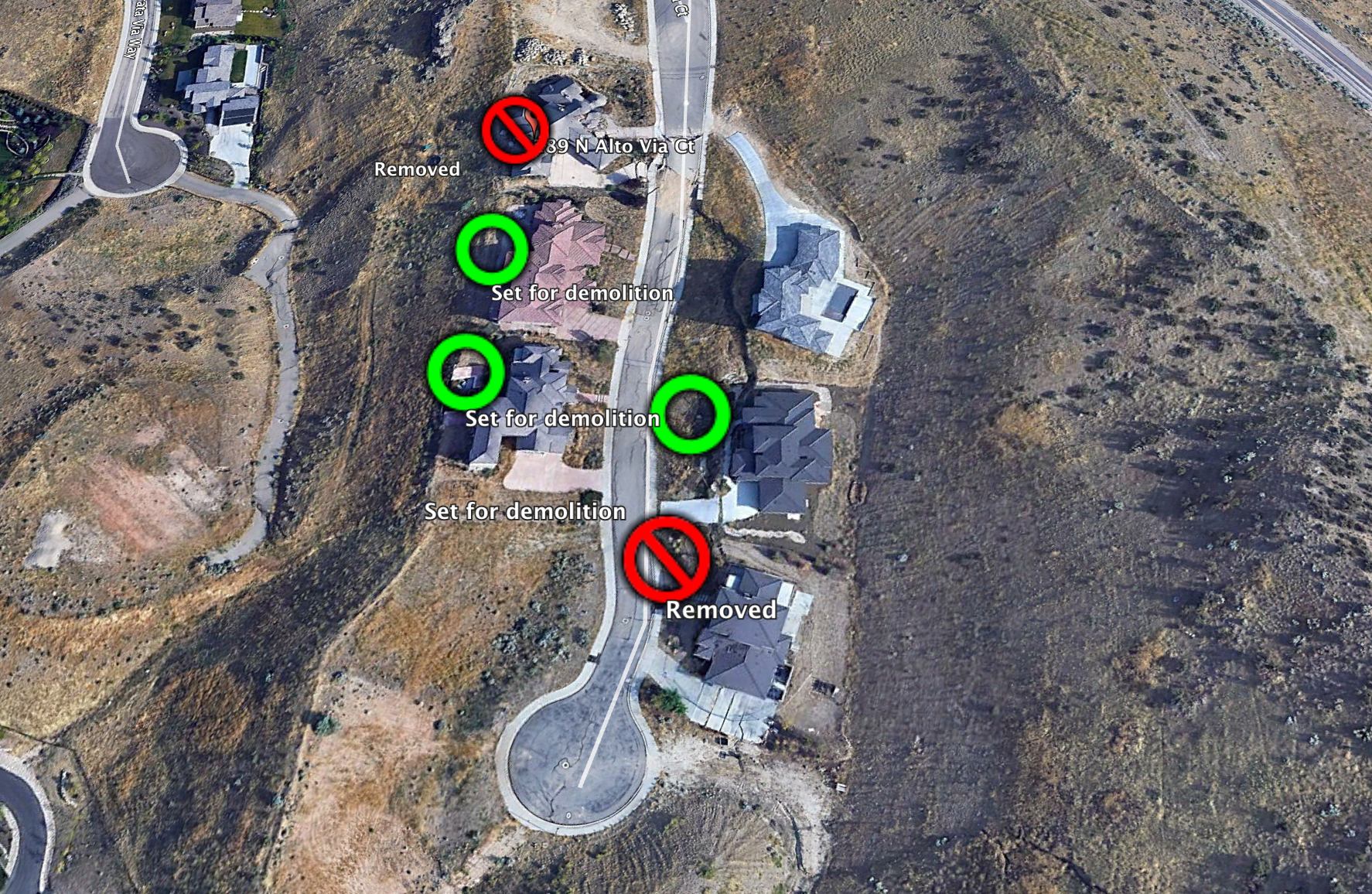 Homes already removed marked with a 🚫. Homes set to be torn down marked with a green circle.