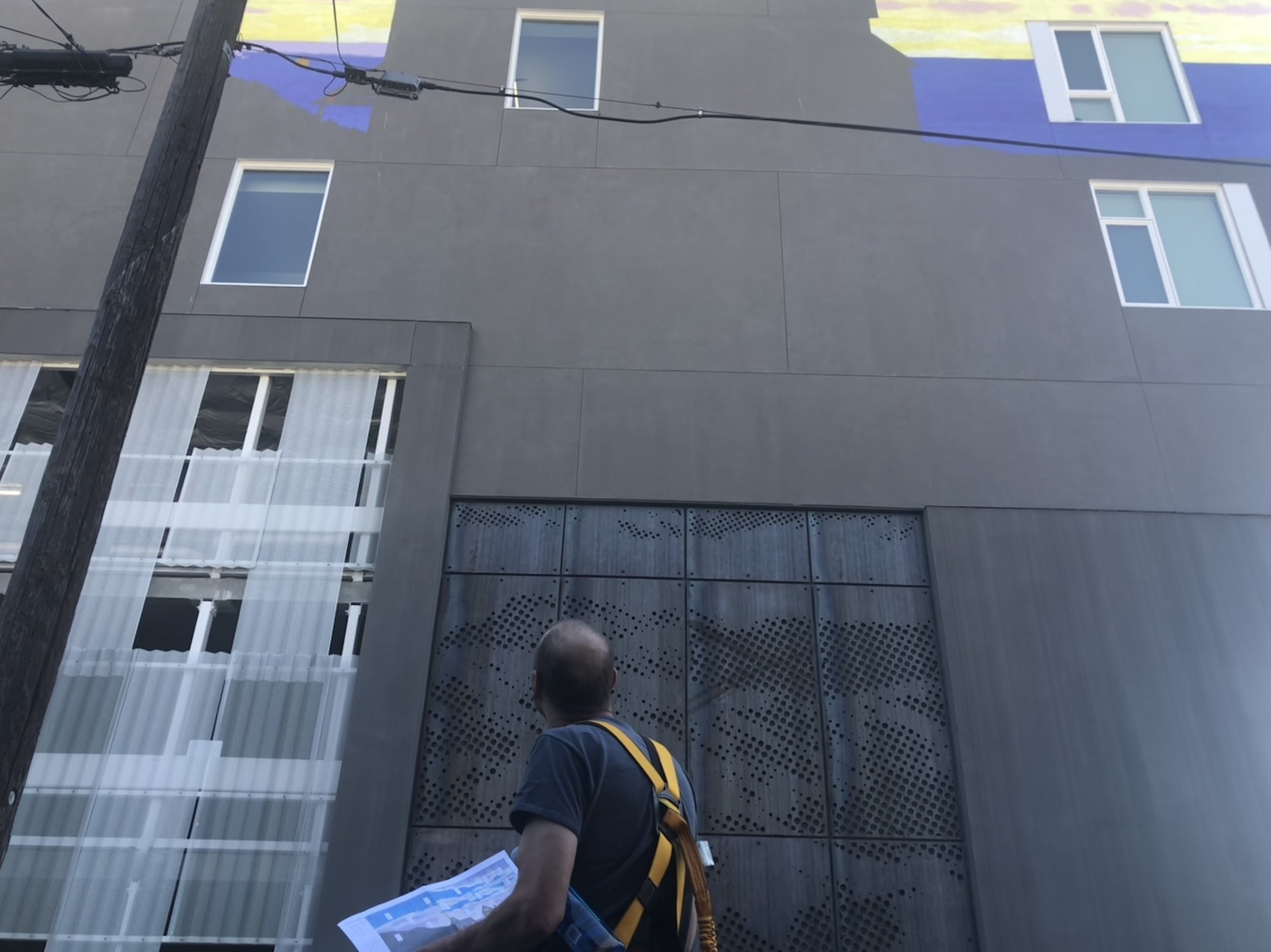 Lewis studies his plan and the building surface he is rendering it on. Photo: Don Day/BoiseDev