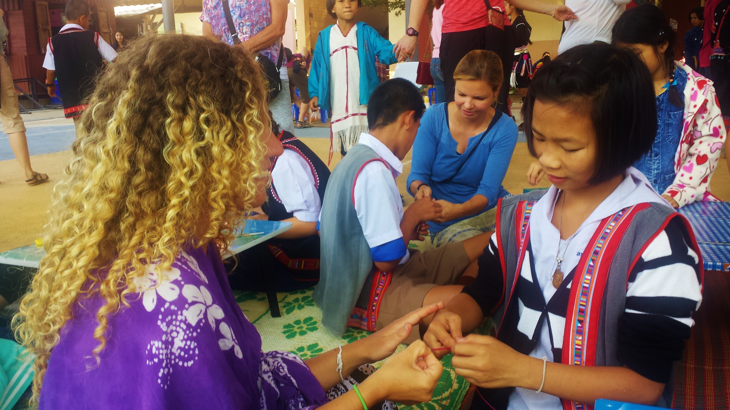Making bracelets with children from a local Thai school in Chiang Mai