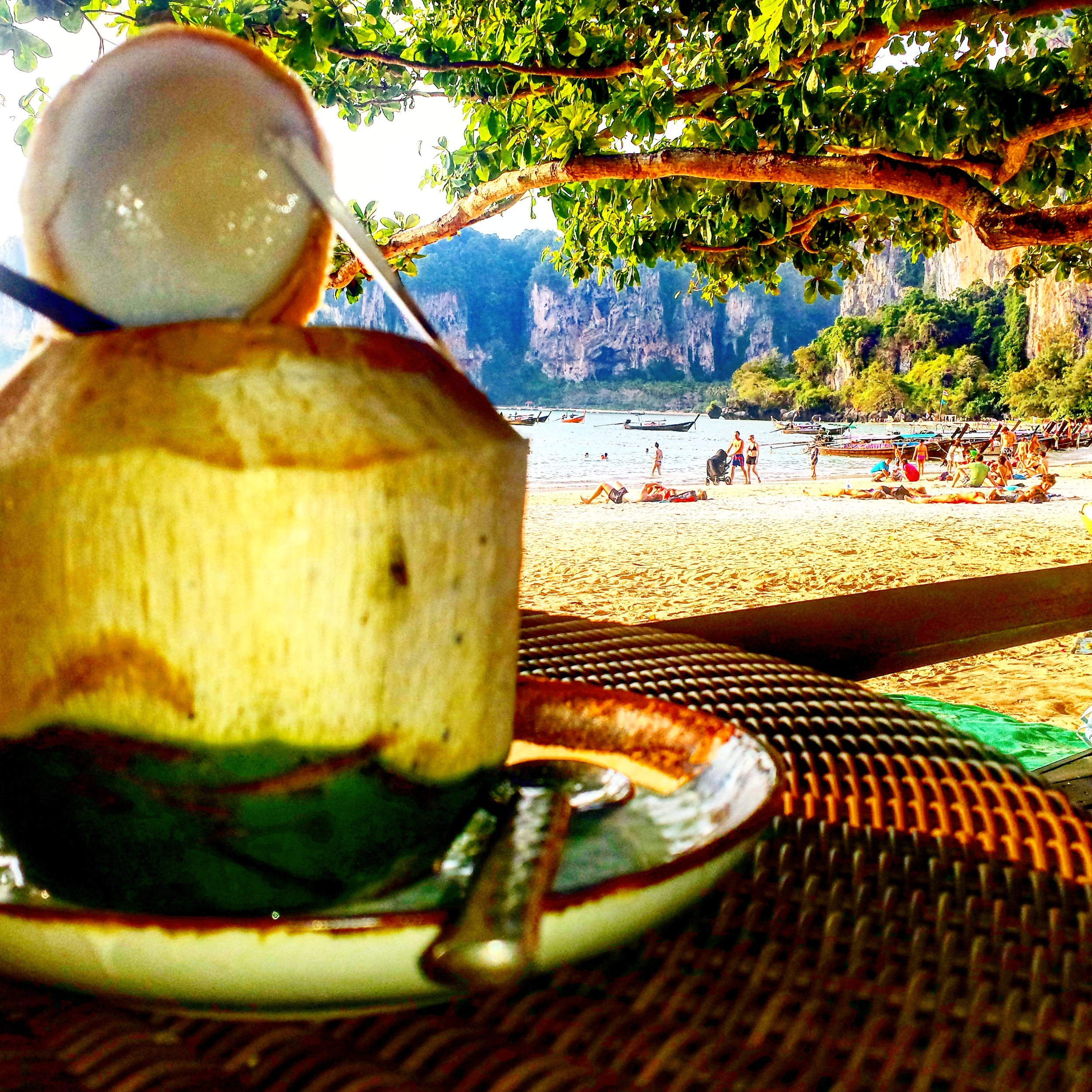 Enjoying a coconut cocktail at a beach front resort on Railay beach.