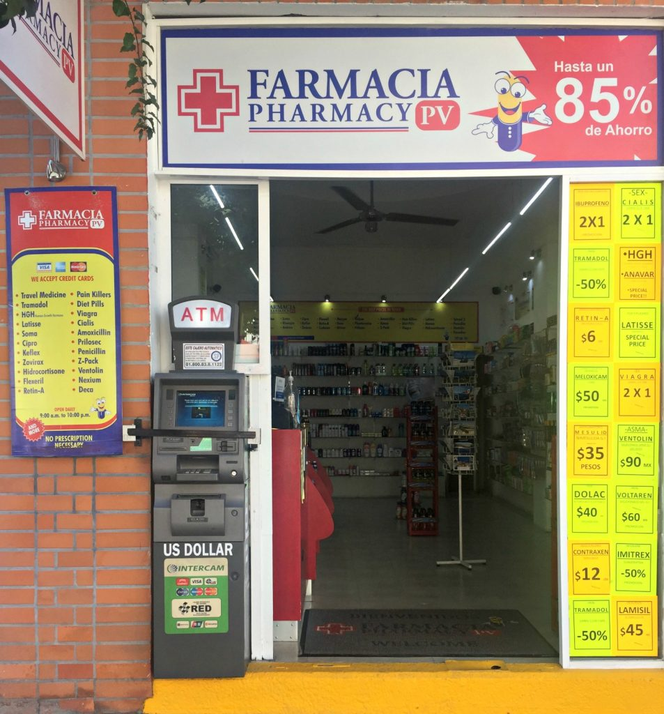 Pharmacy store front with OTC drug prices listed in USD and Pesos