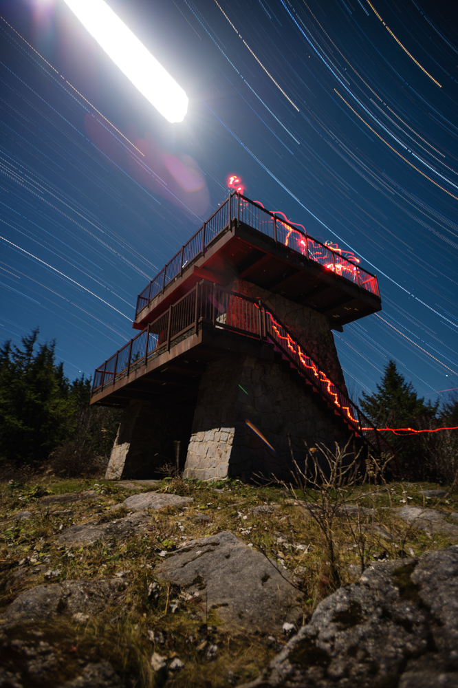 Spruce Knob Observation Tower, as expressed in a star trail photograph.  This was my very first attempt at the technique. I learned a ton in the process, and consequently opened so many potential new ideas. Note the bright white streaked orb is actually the moon.All other light sources depicted are generated from our headlamps while working  The observation tower itself is situation 4,863 feet above sea level - the highest peak in West Virginia, and provides a most excellent unobstructed 360 degree panoramic view.