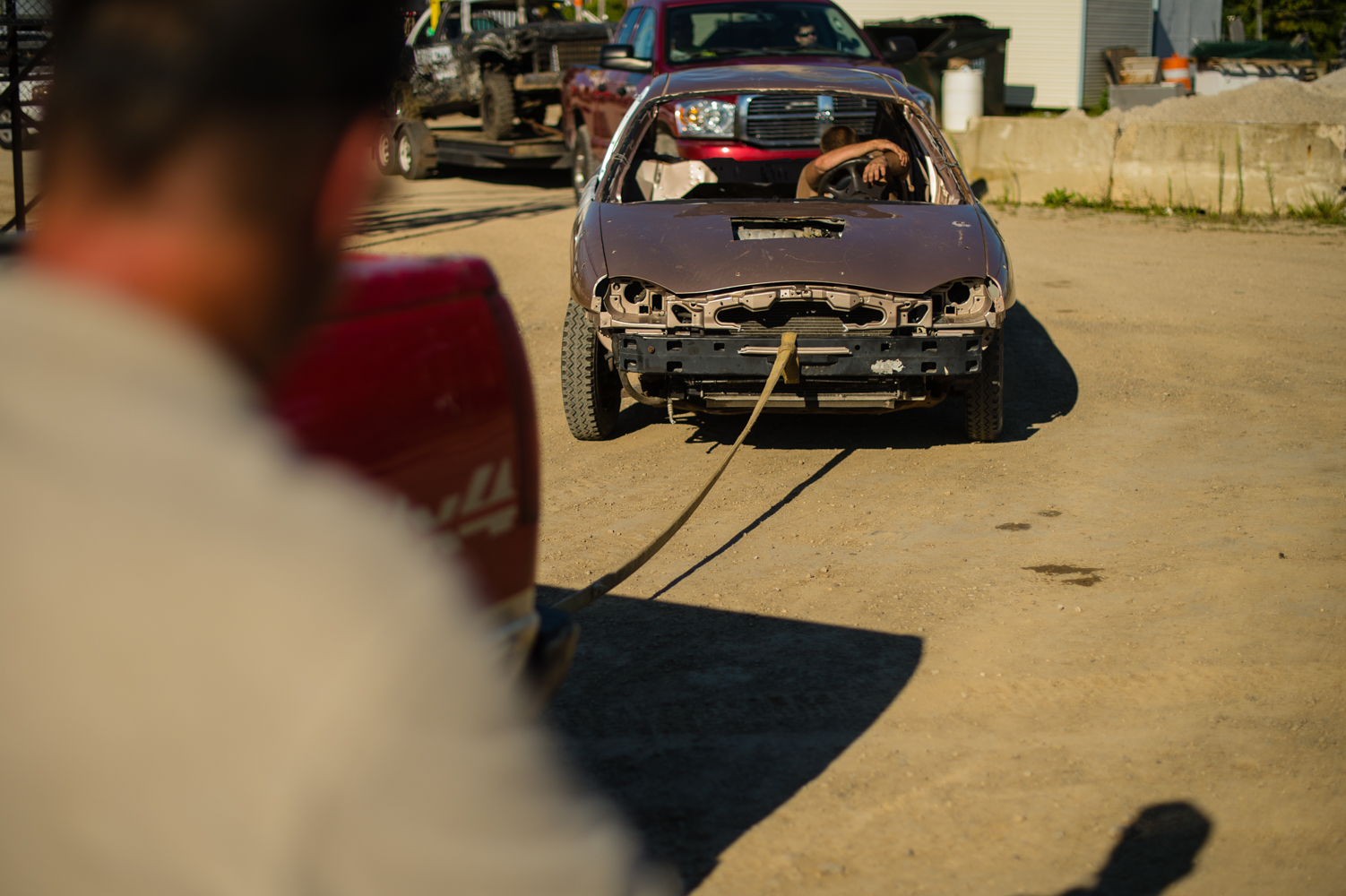 A derby contestant is towed into the inspection pit in New York.