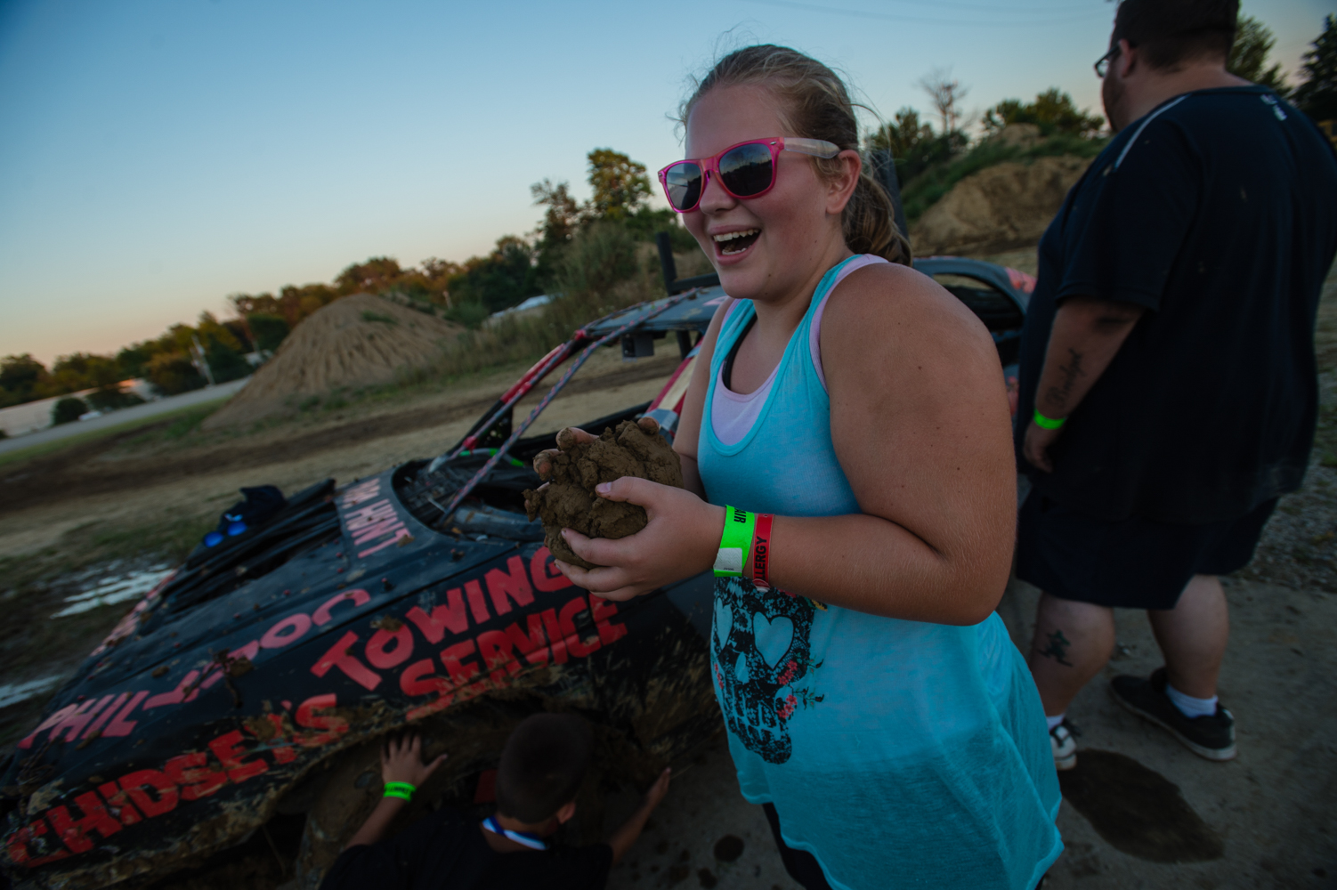 A contestant's sister collects the mud that falls off winning cars from each race.