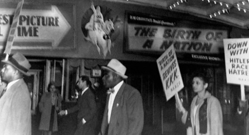 Members of the National Association for the Advancement of Colored People picket under the marquee of the Republic Movie Theatre against race discrimination featured in the movie, The Birth of a Nation. They carry signs asking for a ban on hate films. Flushing, New York, October 20, 1947. Image courtesy of © CORBIS.