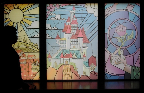 The Alien silhouetted by Beauty and the Beast window at Epcot, WDW, Florida