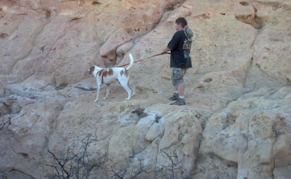 The author with my hound dog, Jake, as Sandstone Bluff, El Malpais State Park, NM