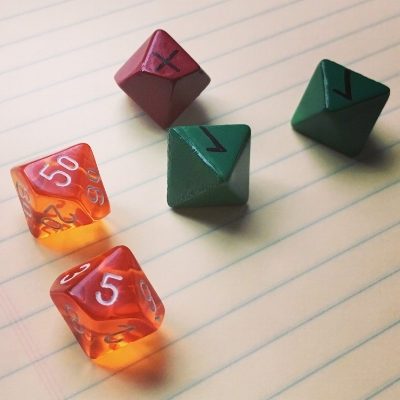 The prototype advantage and challenge dice used in playtesting.