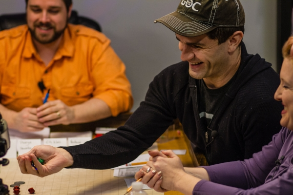 Playing with prototype dice during the filming of an actual play session. Left to right: Rodney Thompson, Sam Witwer, Elisa Teague. Photo by John French.