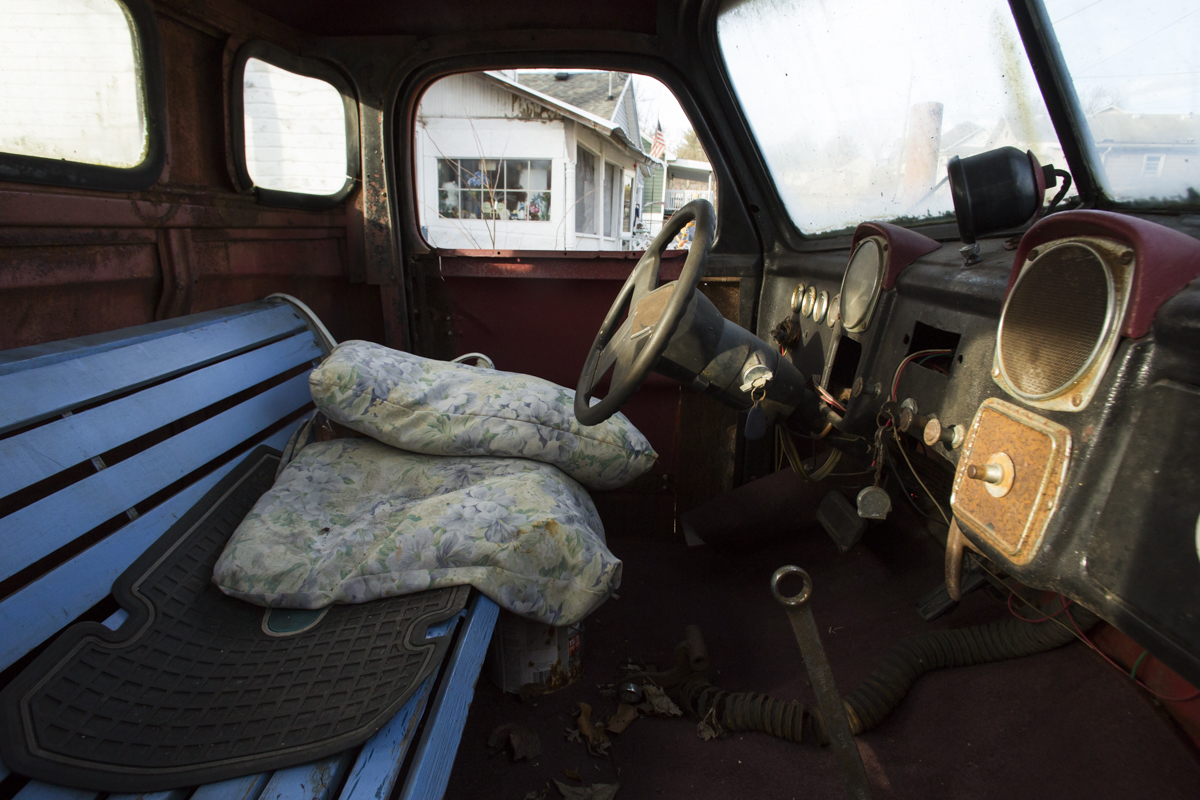 Dale Blosser remodeled the interior of his truck with an old park bench for a seat, and wrench for a gear shifter. Blosser has been living off of unemployment checks since he was laid off from his last job. He enjoys building projects like this truck with scrap wood and metal to help pass the long days.