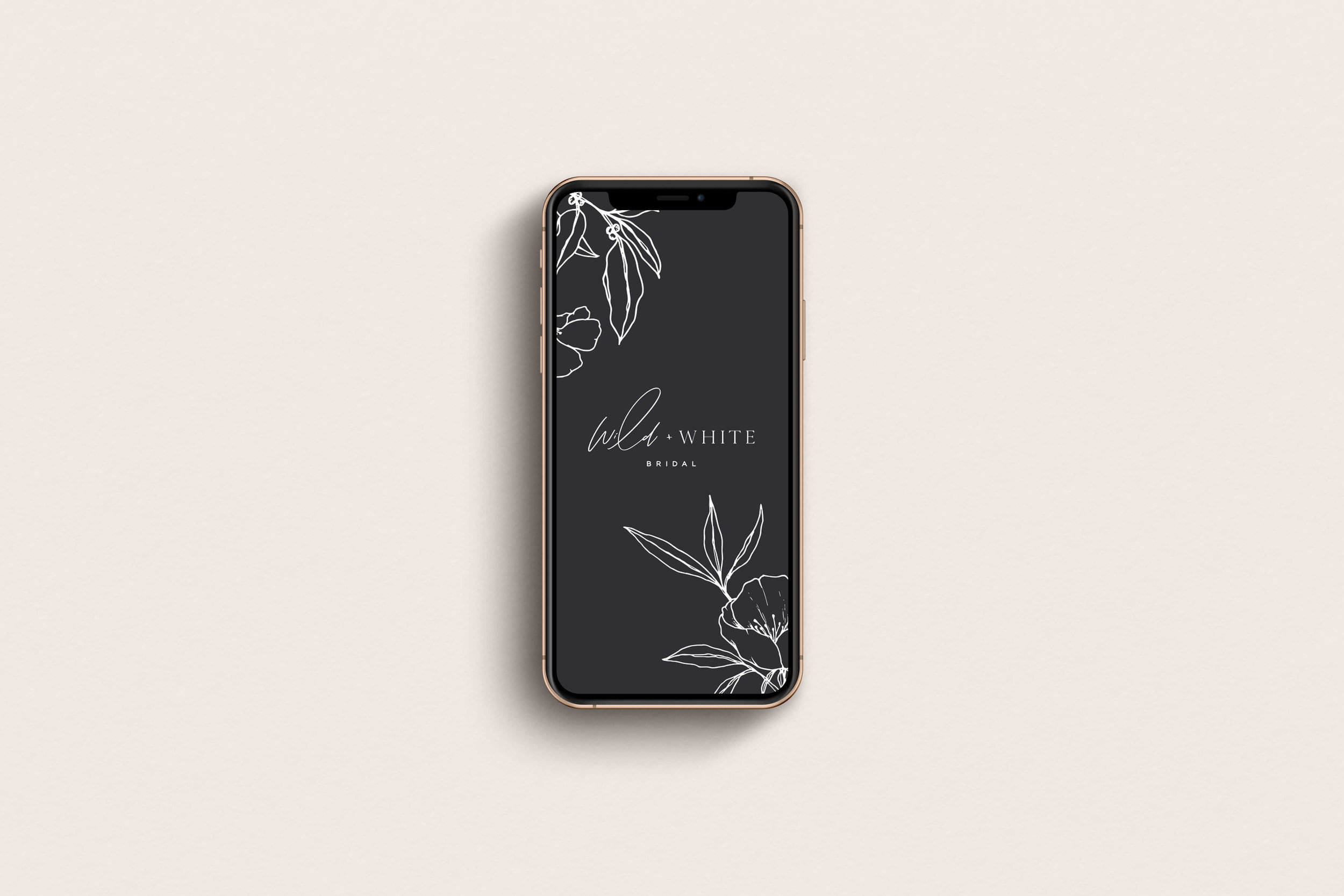 Wild and White Bridal logo on mobile - by January Made Design