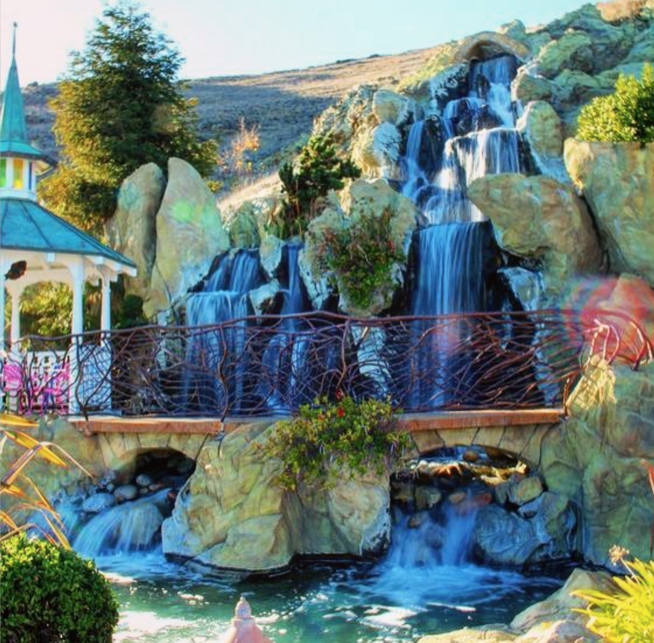 They have a pool with a waterfall.