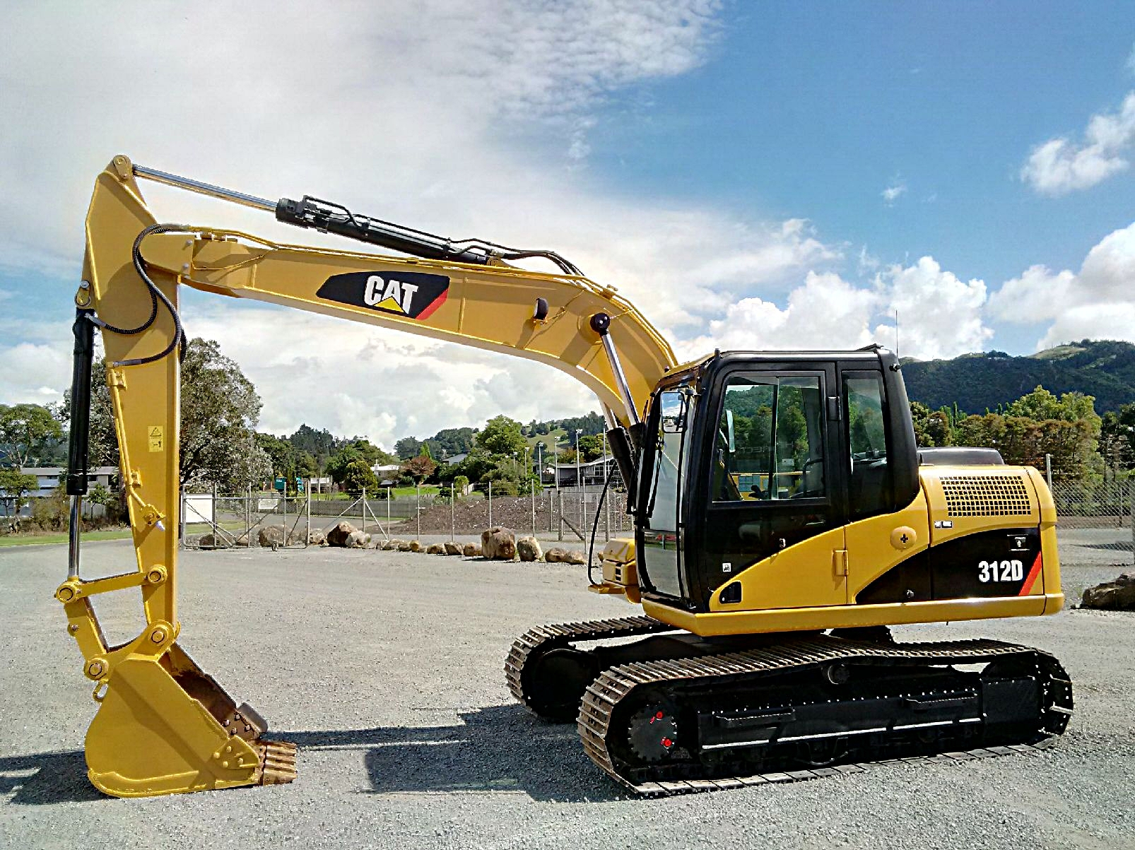 2012 CAT 312D excavator fitted with GP bucket