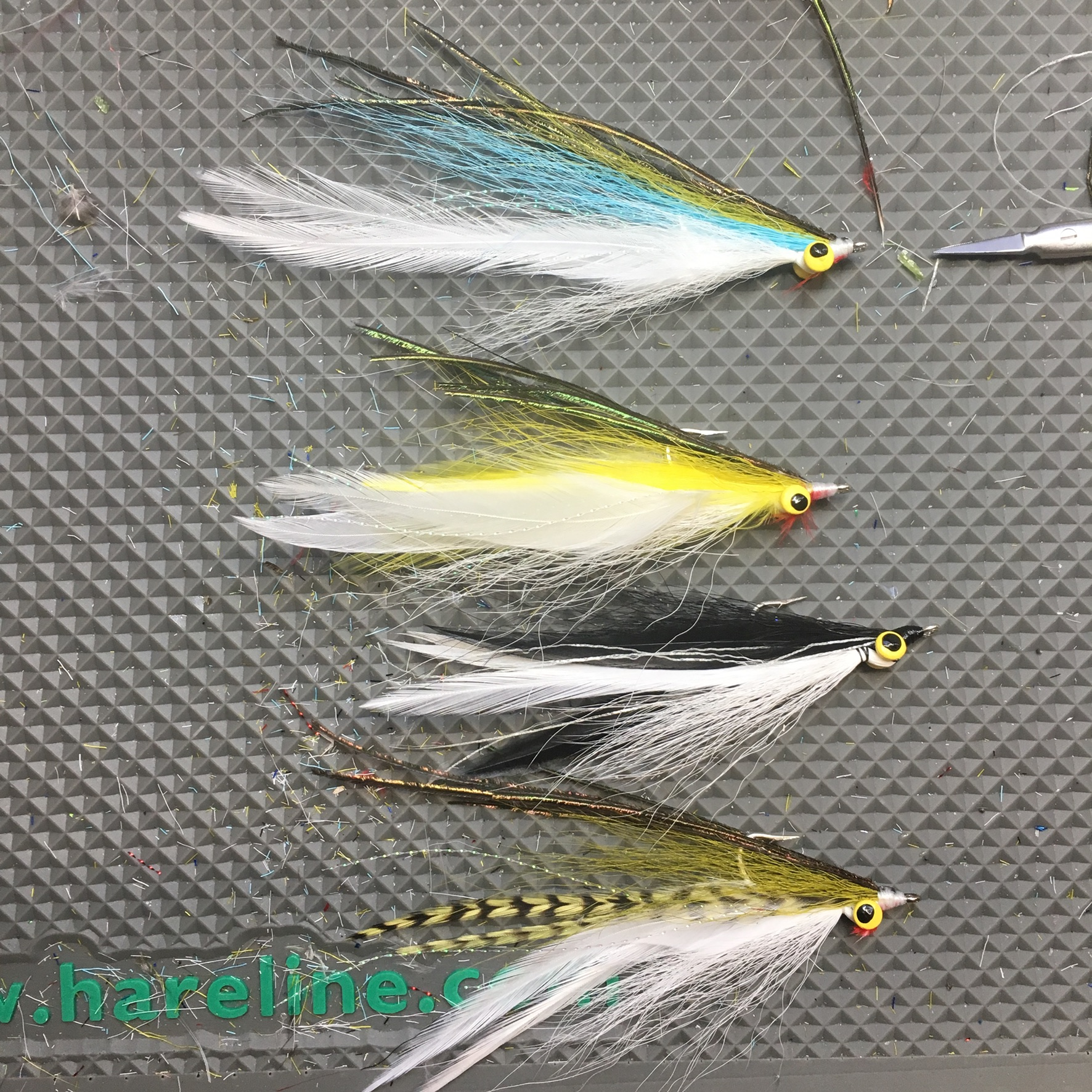 Half-and-halfs combine the action of clousers with profile of deceiversers. These are tied to imitate a variety of bait fish including herring, pollock, mackerel, and a genereic black and white for low light conditions/