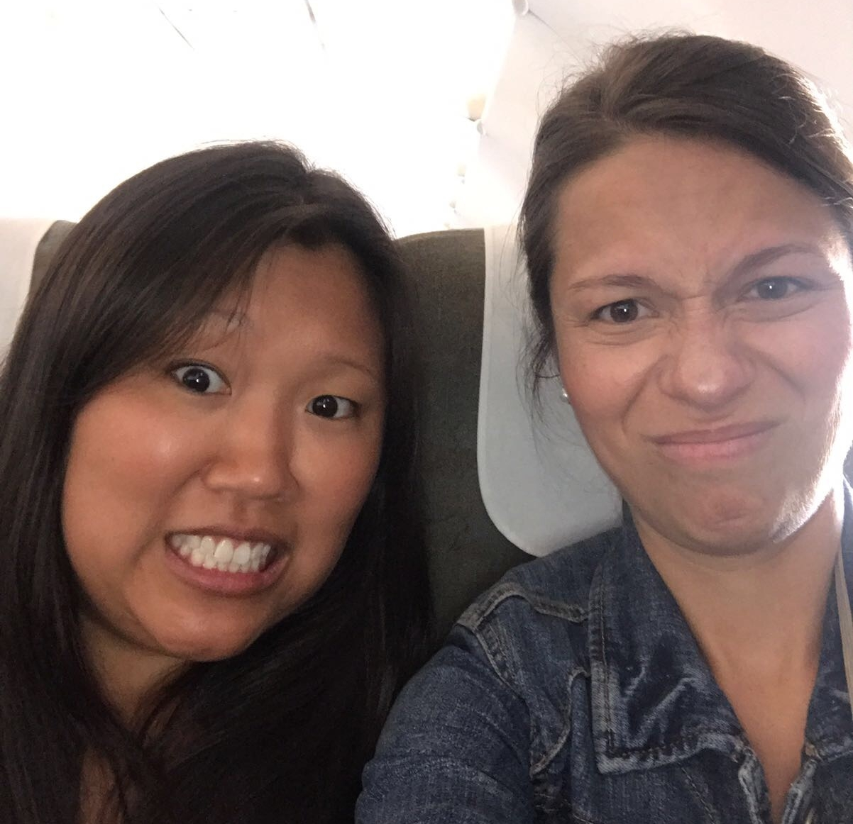 A pic Kara and Leigh Anna sent us from their flight to Saigon -- immediately after the plane's cabin had been fumigated with insecticide and the passengers behind them stuck their bare feet through the seat gap to use the armrest as a footstool