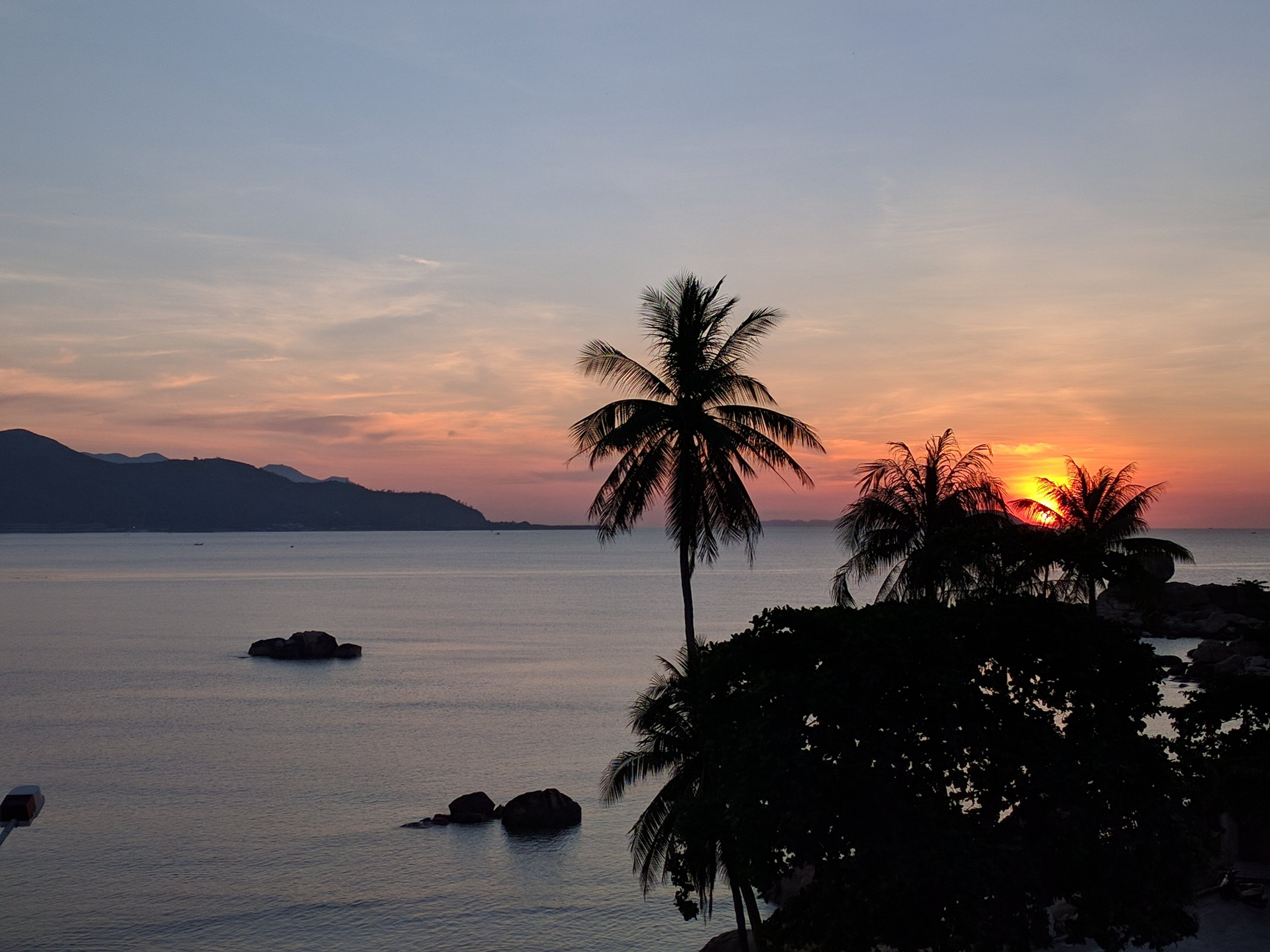 View at sunrise from the balcony of our first hotel in Nha Trang