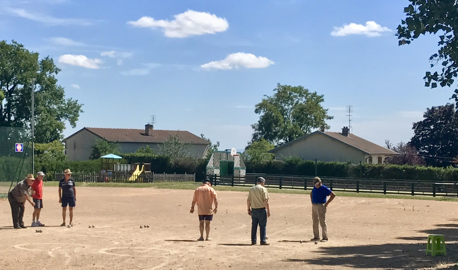 Scenes from our drive through the villages...A midday boules game in action