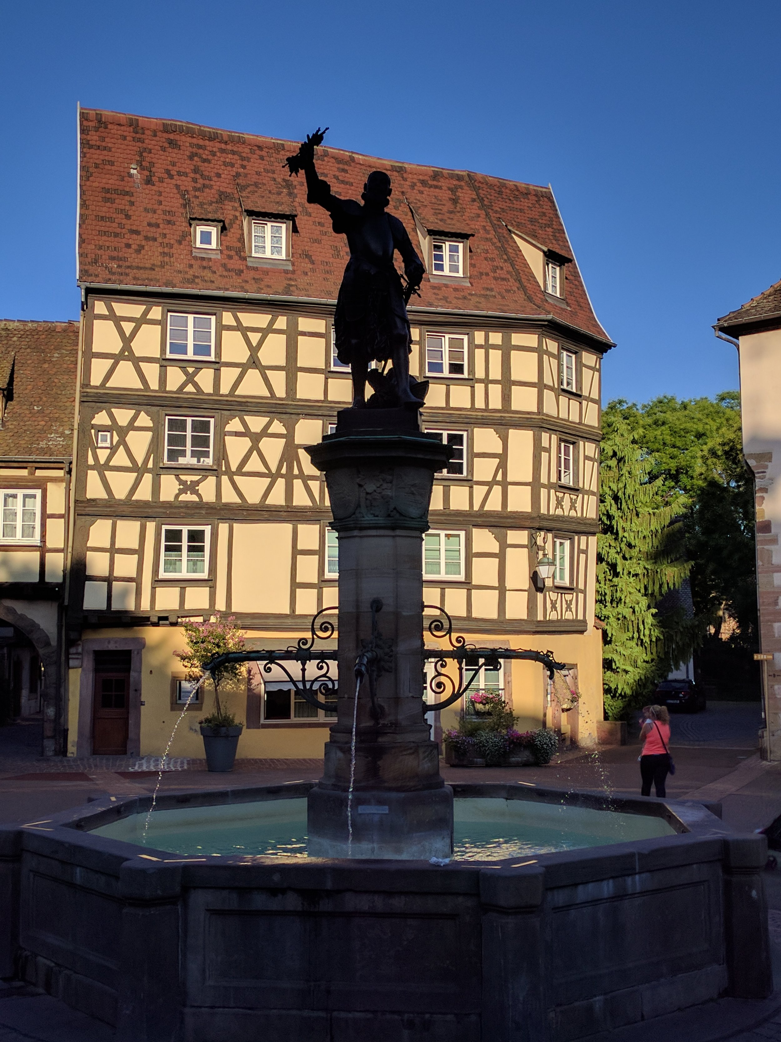 A statute across from the wine hall in Colmar depicting a victorious noble returning from battle in Hungary with Tokay grapes that were subsequently introduced to Alsace (and renamed Pinot Gris); The statue was designed by Frederic Bartholdi -- designer of the Statue of Liberty and native of Colmar