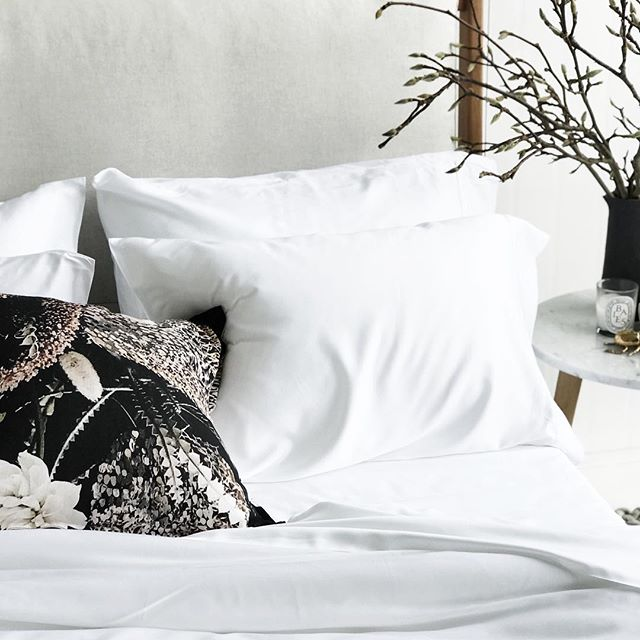 Our Banksia cushion snuggling into the dreamy soft bamboo bedding from @mulberry_threads_co ✨🖤