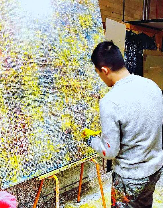 Above: Artist, Wilson Lin painting in his studio in Melbourne, 2018.