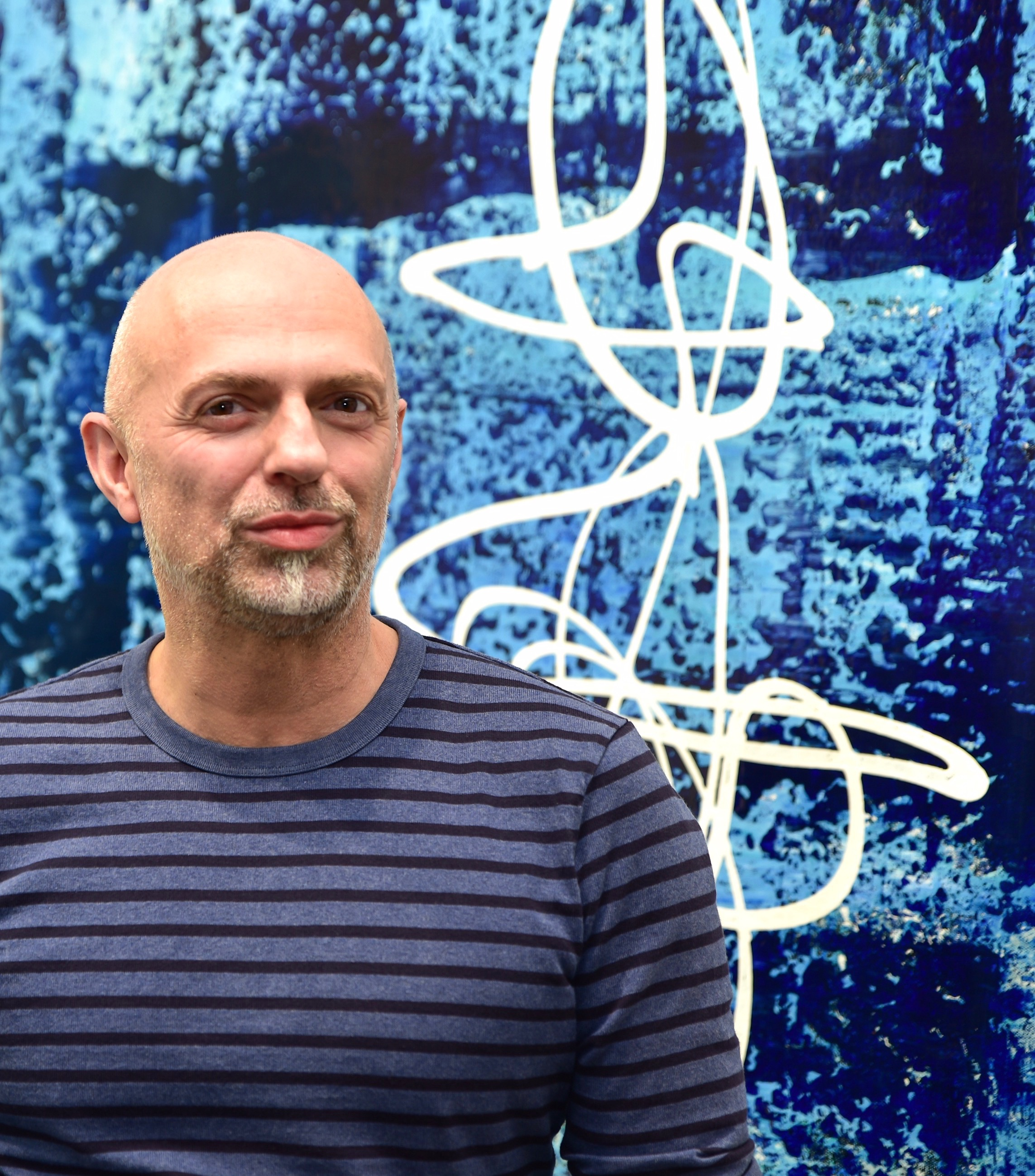 Above: Abstract Expressionist artist Thierry B., pictured in his gallery with painting, Z ensation , 2017, Synthetic Polymer Paint on Linen, 183 x 183cm, P.O.A