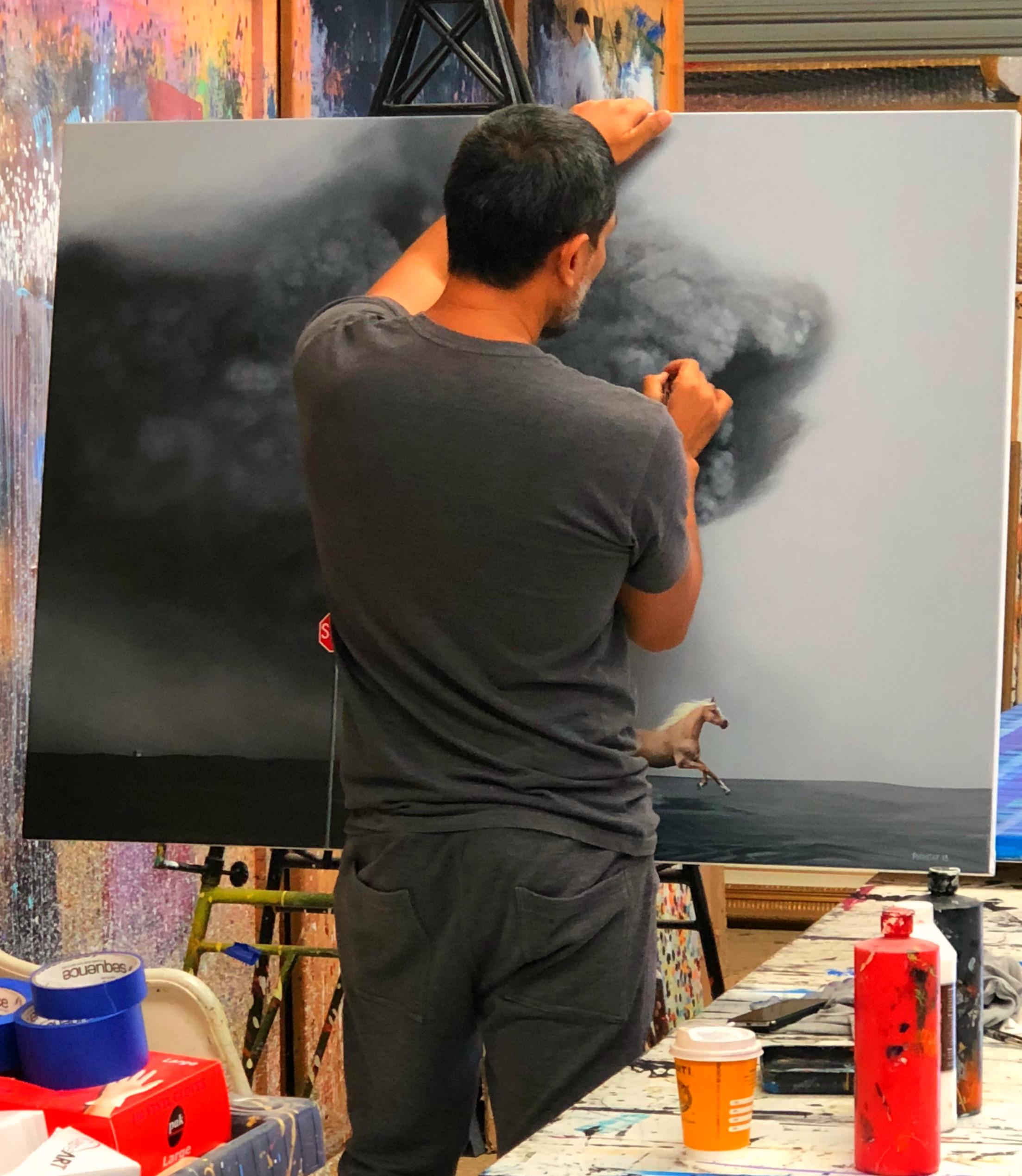 Above: Hyper-realism artist, Phonsay painting in his Albury-based studio.