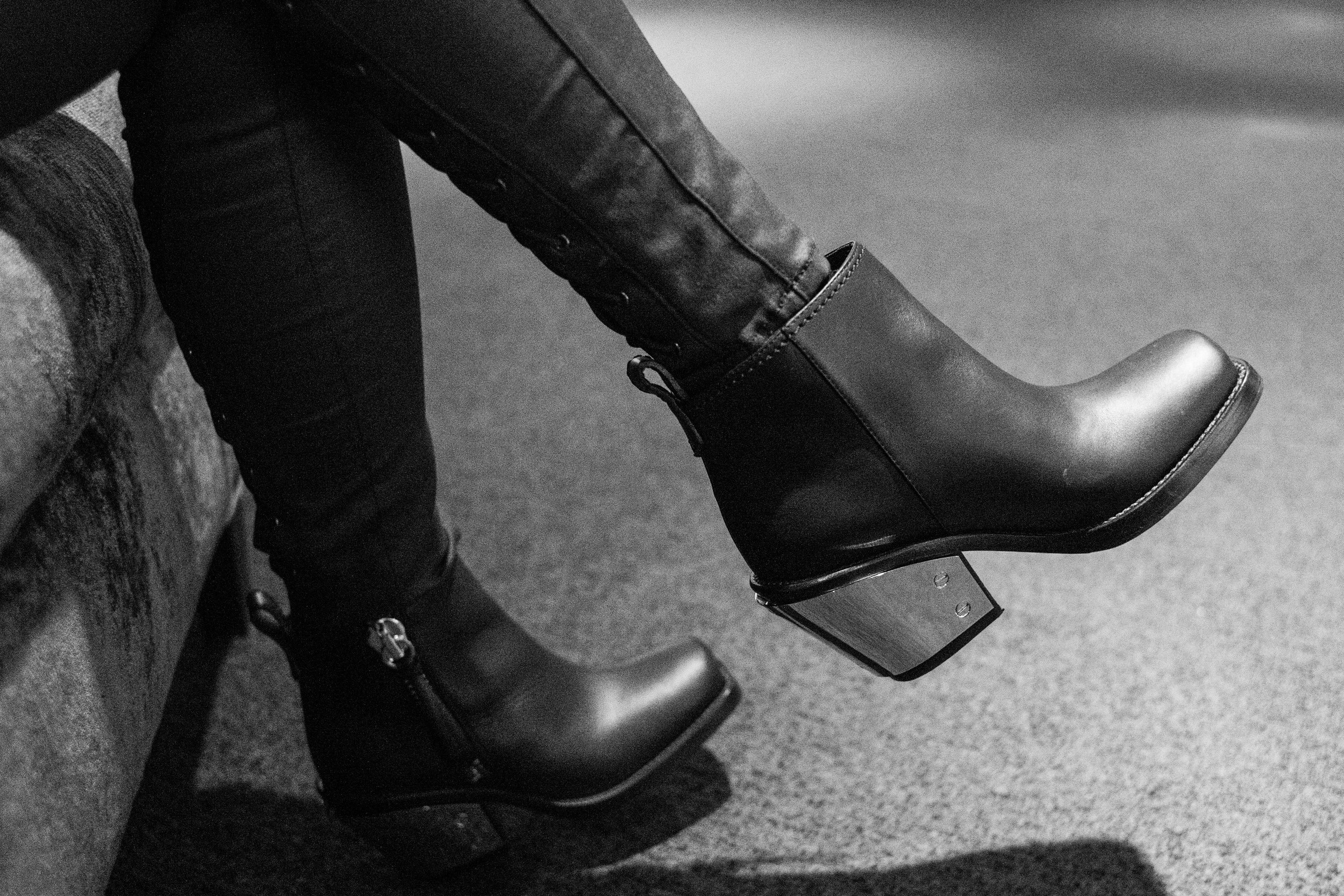 This must be art. It's a deliberate close up of someone's designer ankle boots.