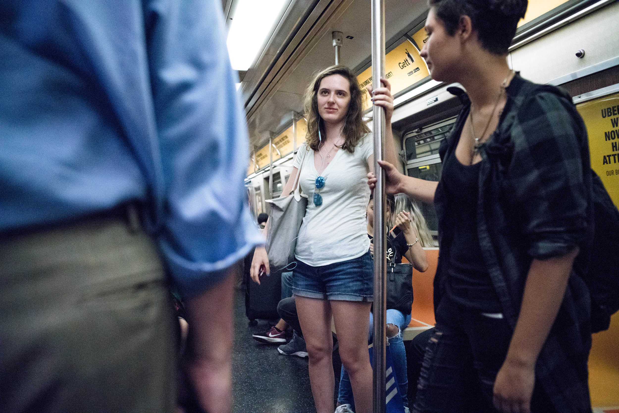The only thing worse than the lighting on the Express Train is the Local Train. I do not understand that ghastly greenish tinge inside the subway car. Thankfully, the Sony A7r MKII's better white balance made it easy to fix in post. A Leica M240 or M9 would not get this shot.