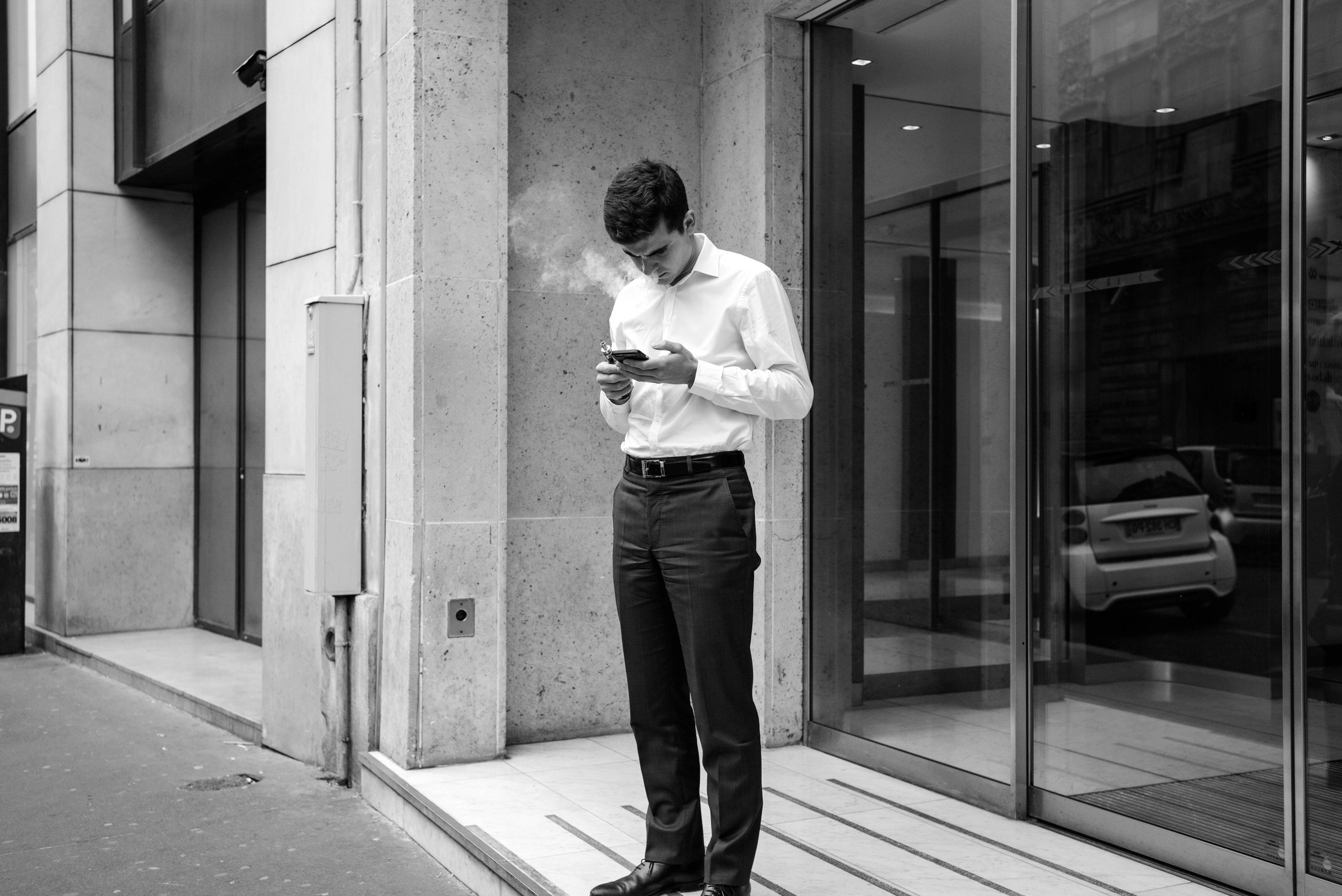 Honestly, there is nothing interesting about this street capture. Another man smoking in Paris. How very unoriginal.