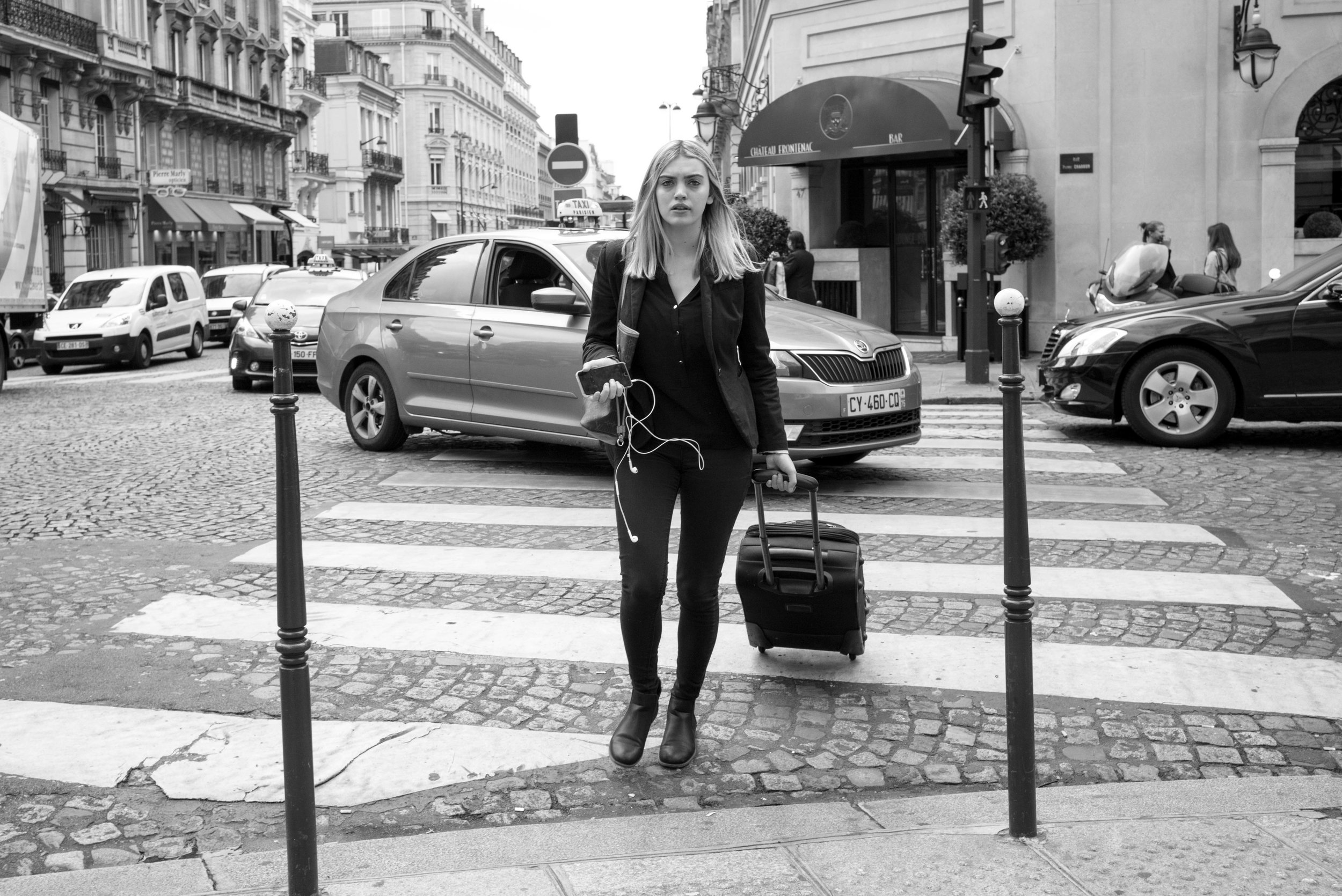 A final example of another opportunistic image capture. I liked her silhouette, but I hated her rolling luggage and the car turning behind her. This is why it is important to be more observant than opportunistic. Getting the perfect shot without thought and preparation is near impossible.