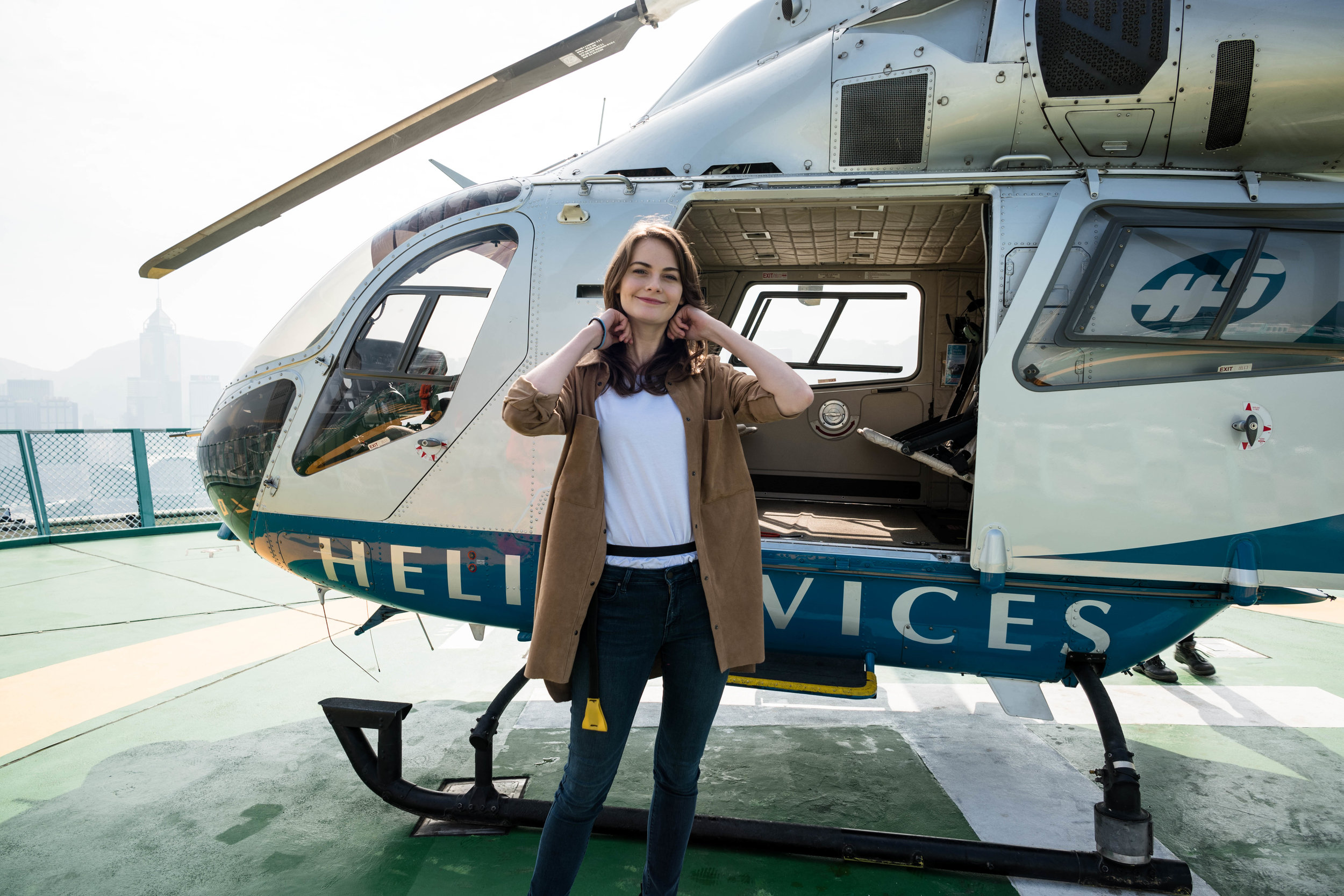 Boarding the helicopter. Anna already has the life preserver strapped around her waist. It is an aviation regulation requirements.