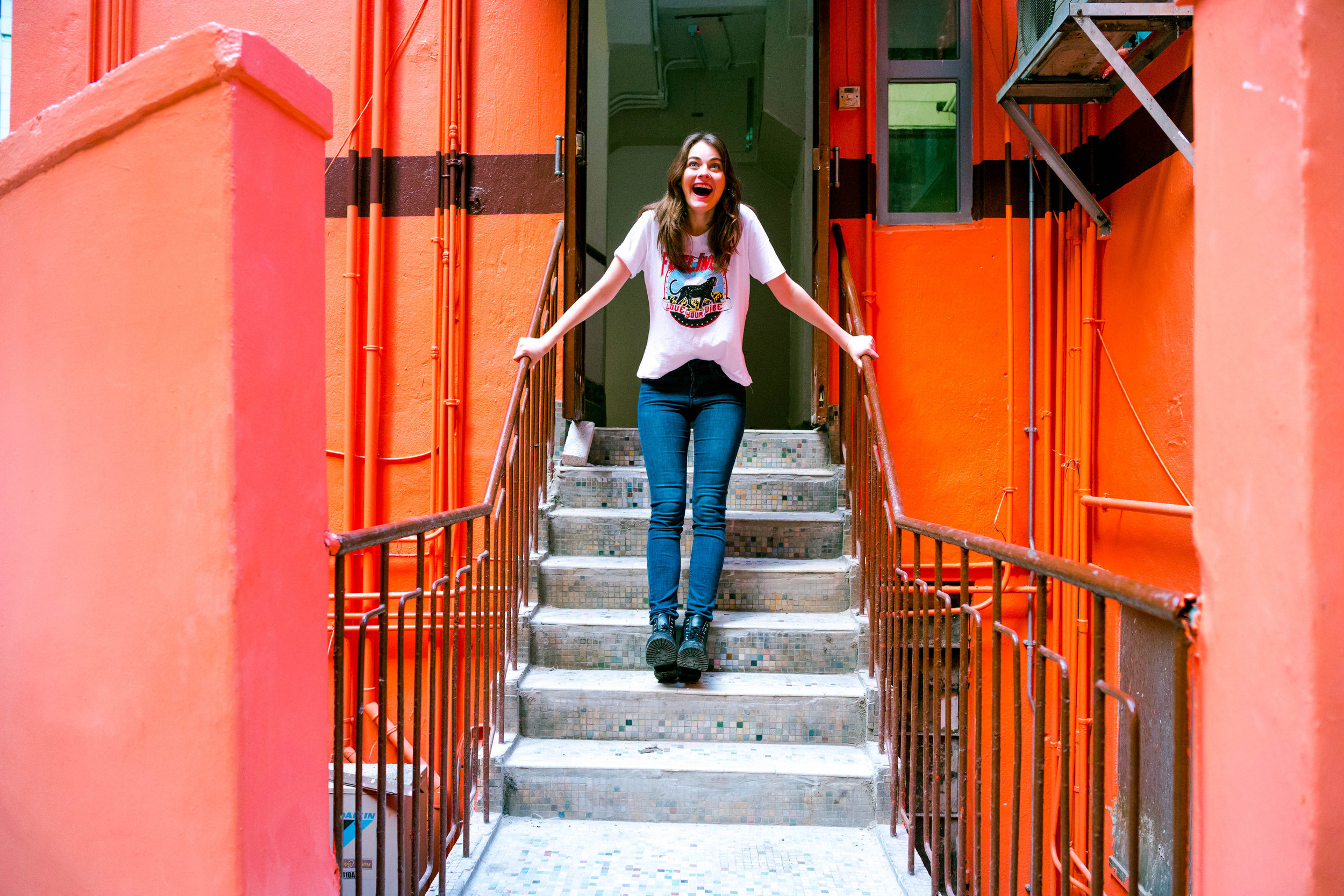 28 Lux, f/5.6 - Fooling around at the entranceway of a very orange structure.