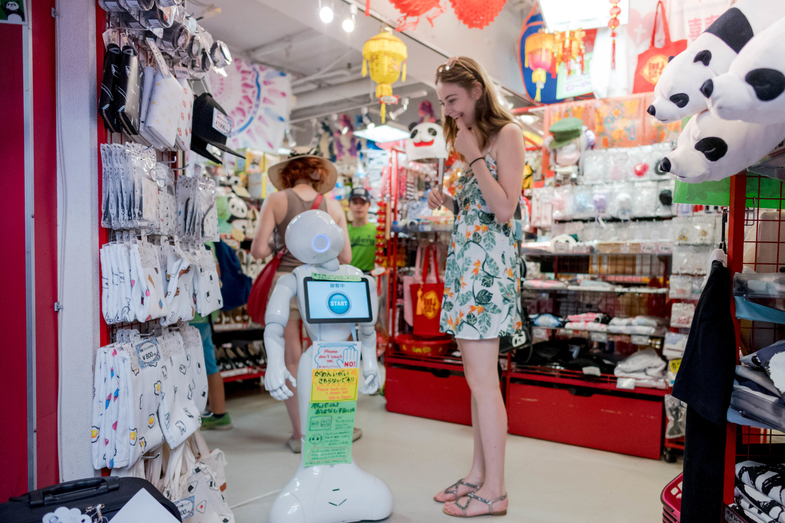 Being amused by a robot in the shop.