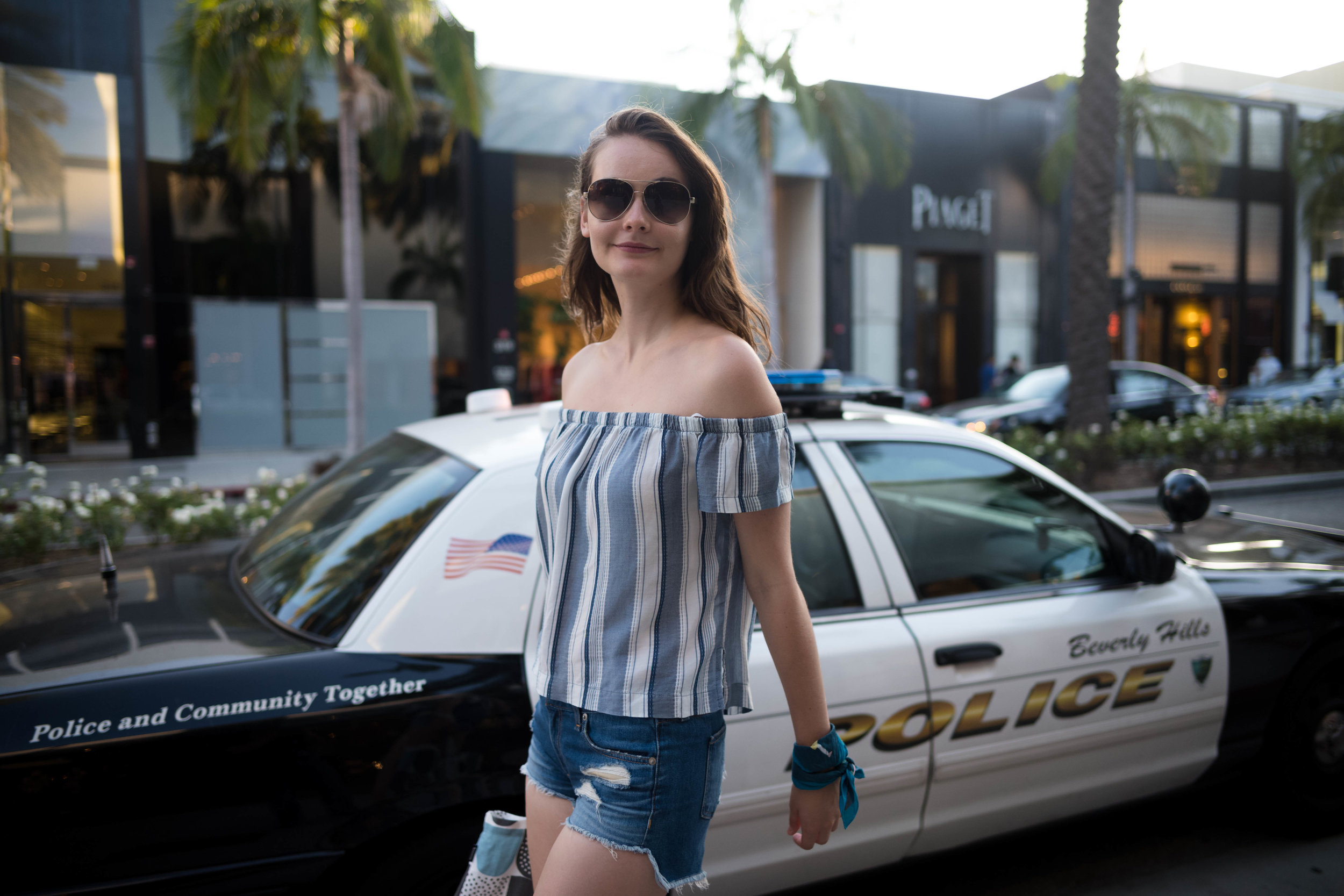 """Walking pass a police car on Rodeo Drive. Apparently, it reminds Anna of the video game """"Grand Theft Auto"""". Leica 28mm f/1.4 Summilux ASPH"""