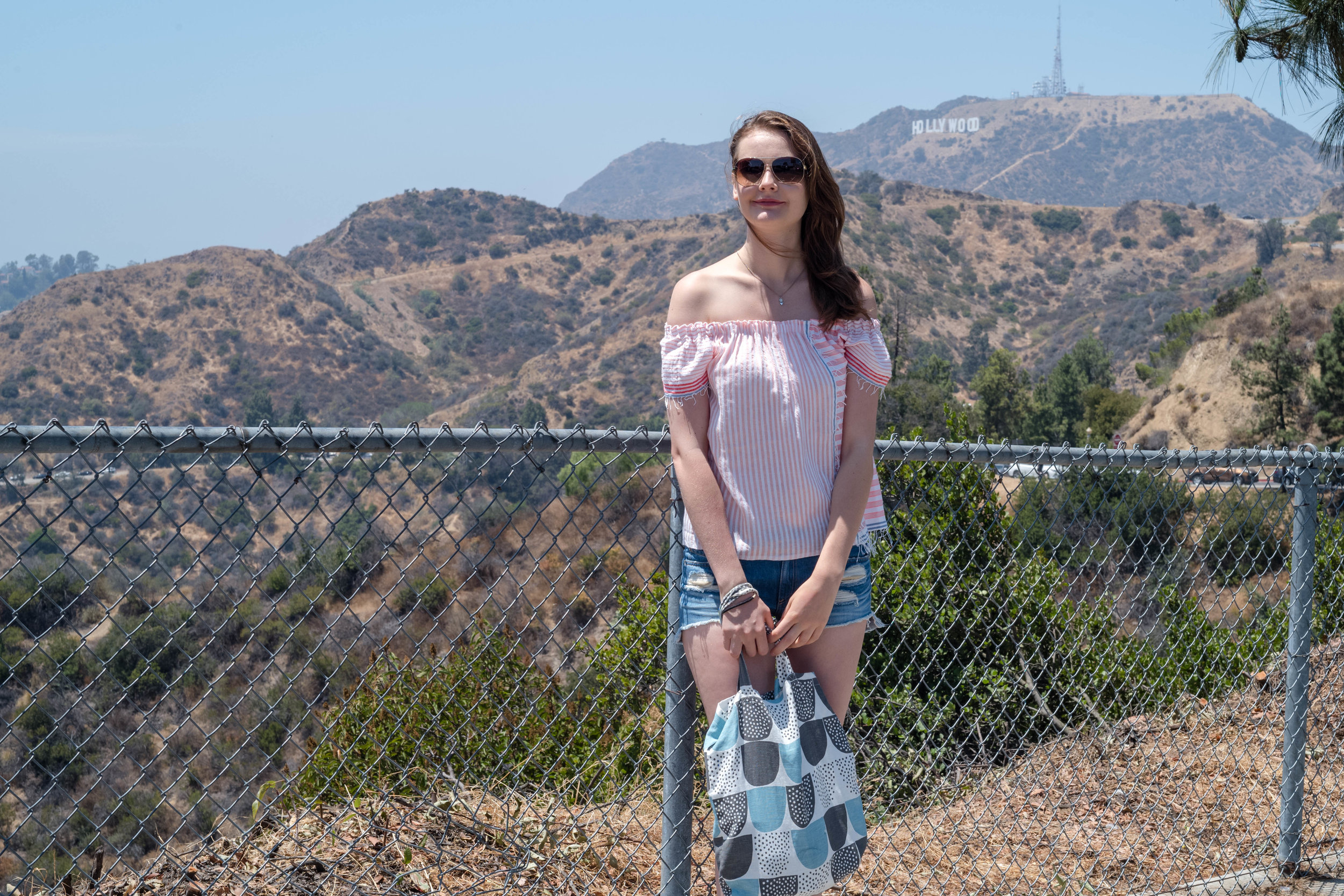 One of many attempt for proof of pilgrimage - Deliberate shot with Anna at the near limits of the depth of field and the Hollywood sign near the far limits - Leica APO 50mm f/2 Summicron ASPH