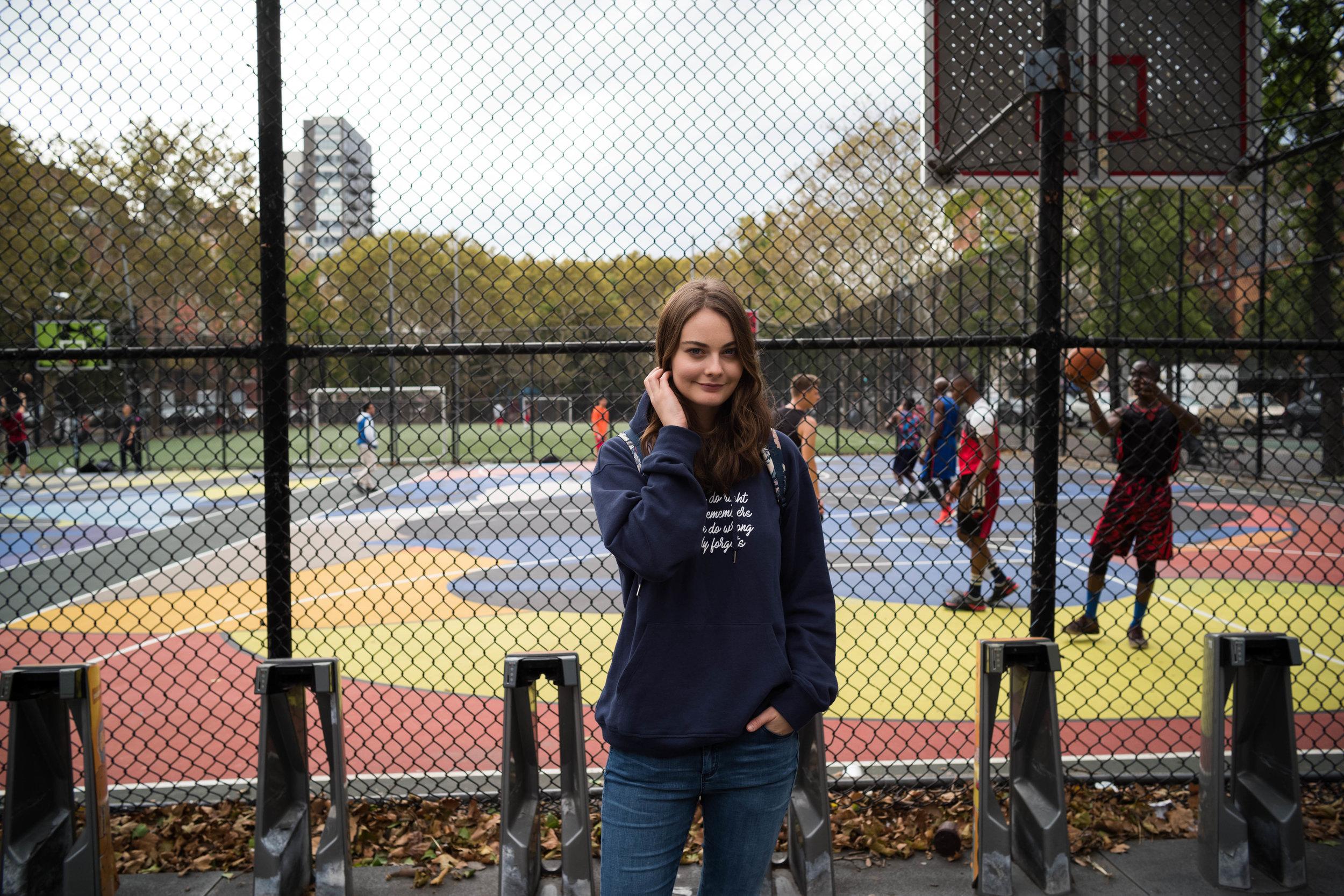 Outside a neighborhood pickup basketball game, on the Lower East Side.