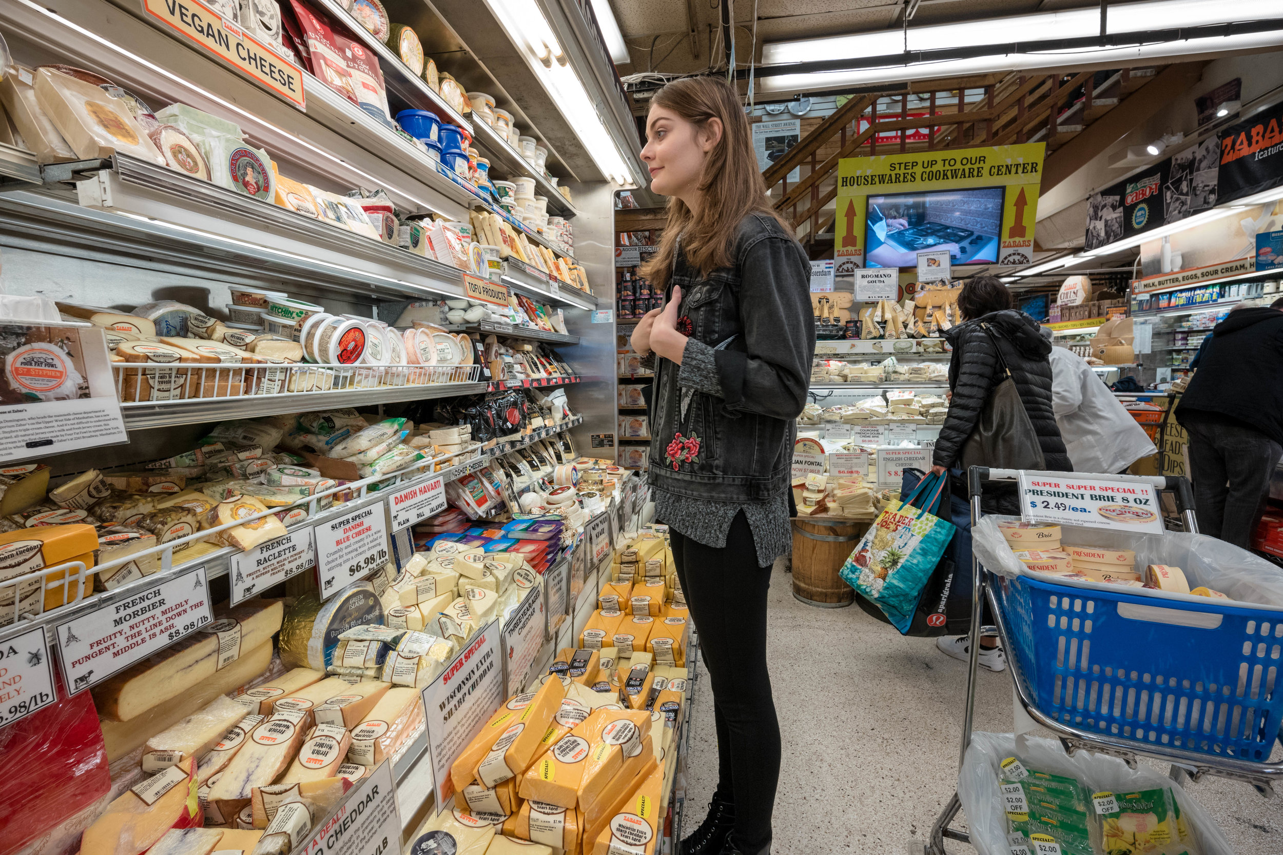 Looking at the cheese selection, inside Zabar's.
