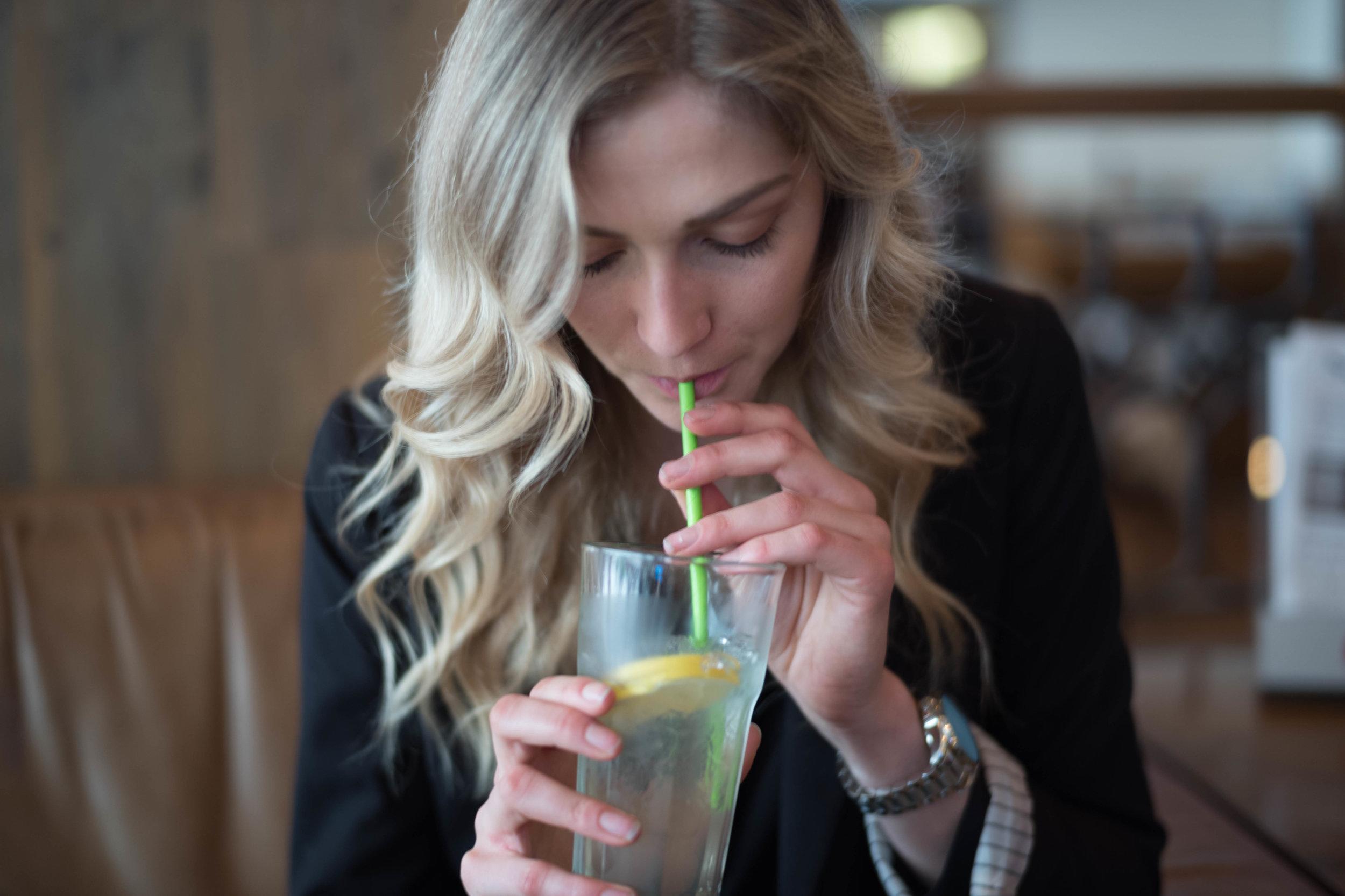 Lydia having a sip.