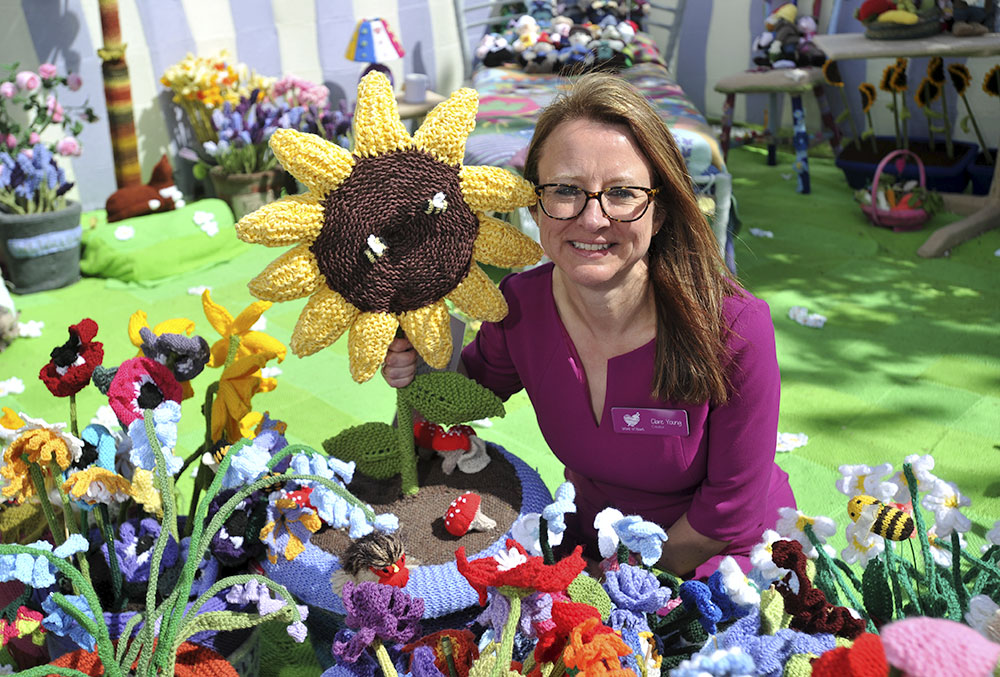 Clare Young with Jane's sunflower