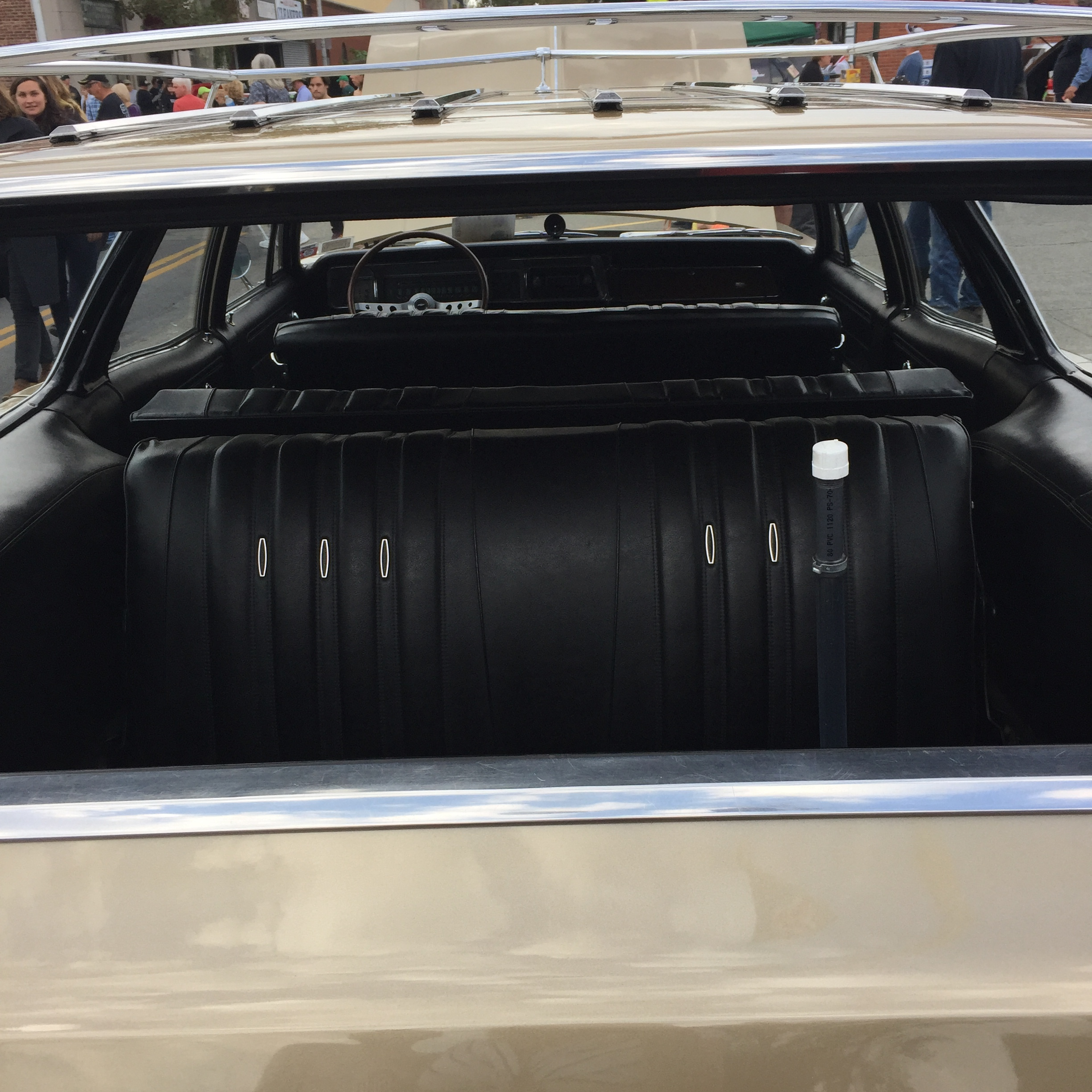 Remember the third seat facing backwards in the Chevy Caprice? Complete with seat belts.