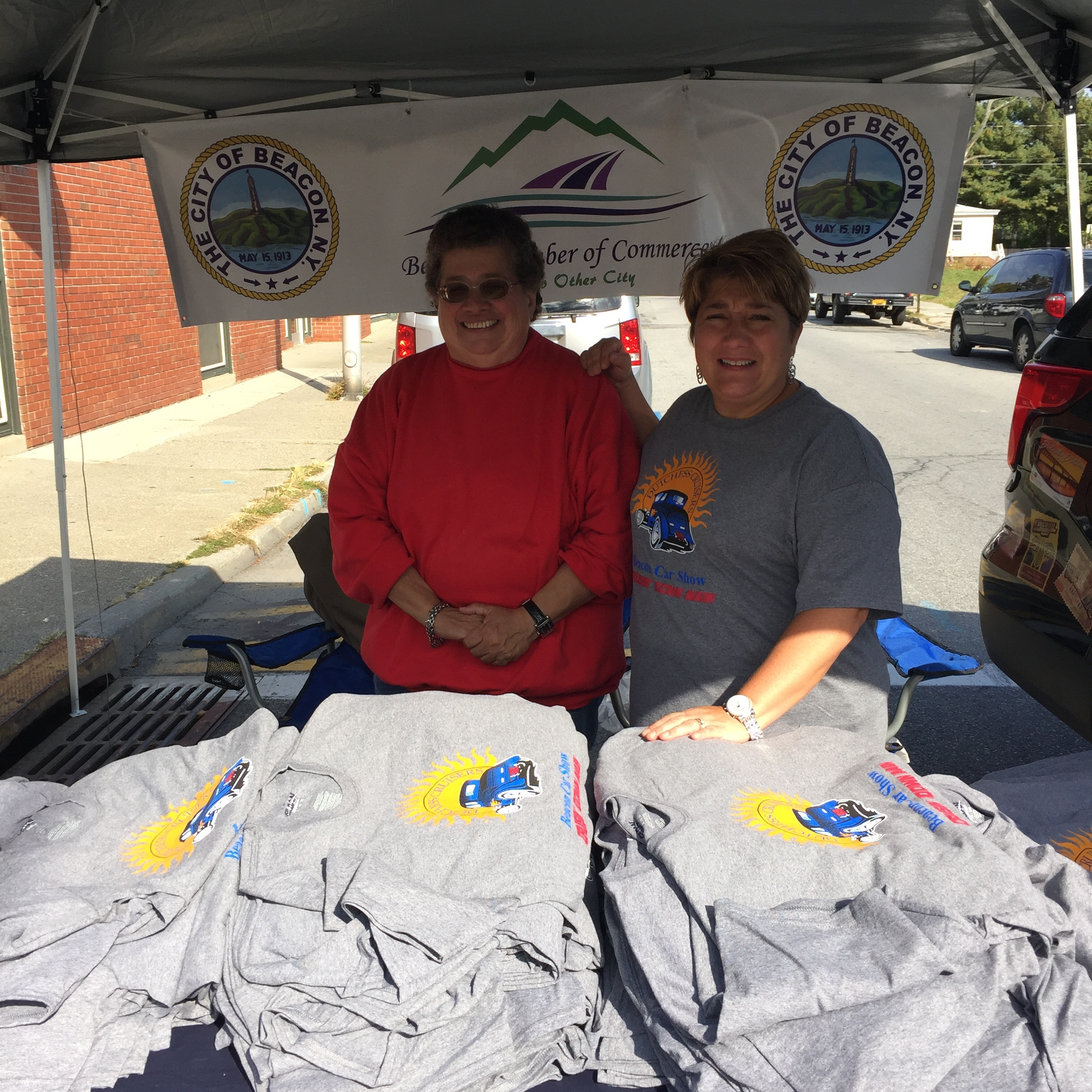 Beacon's Chamber of Commerce, selling t-shirts  UNDER THEIR TENT .
