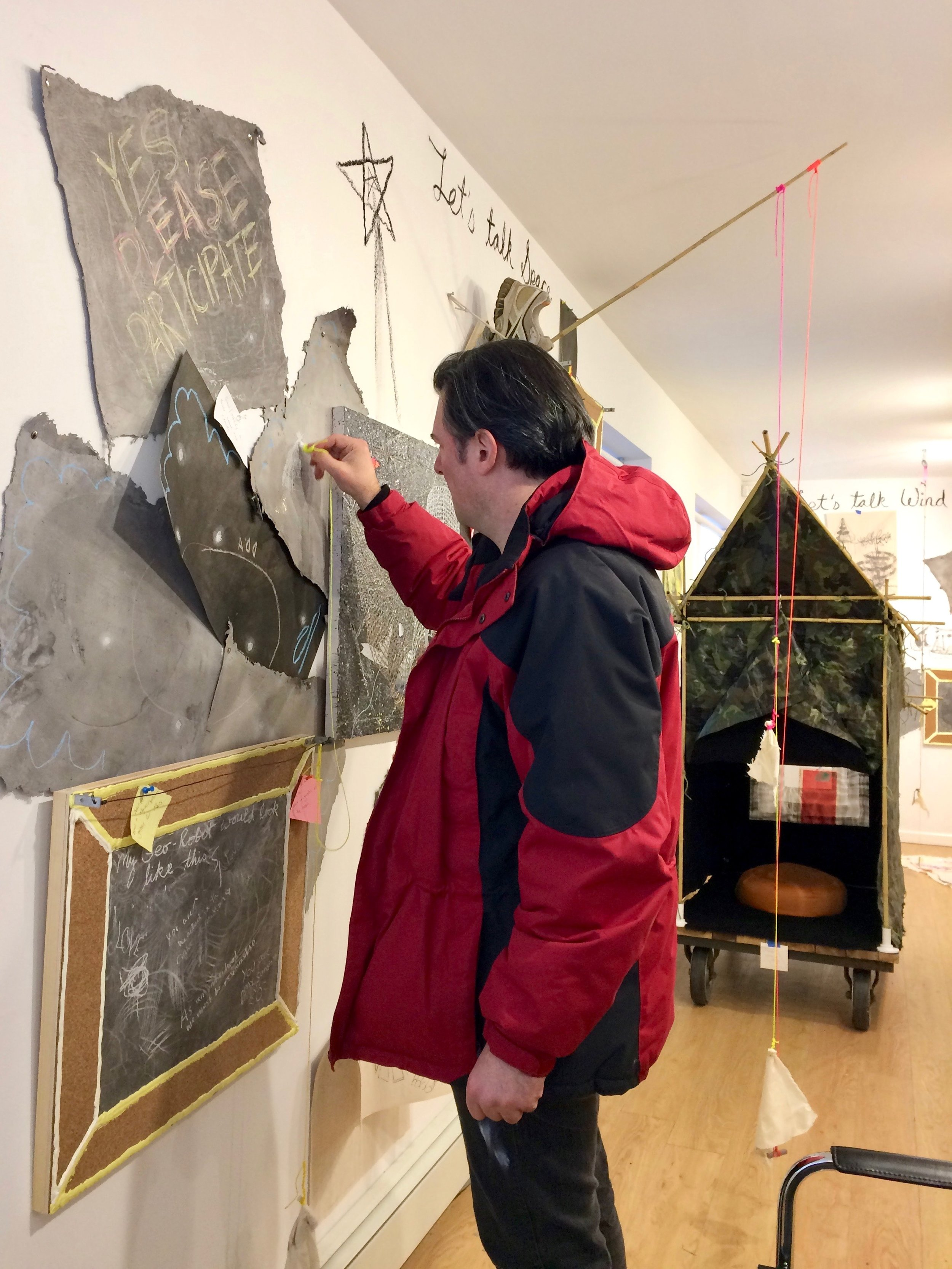 Beacon resident Greg Slick contributes to the installation. Photo Credit: Matteawan Gallery