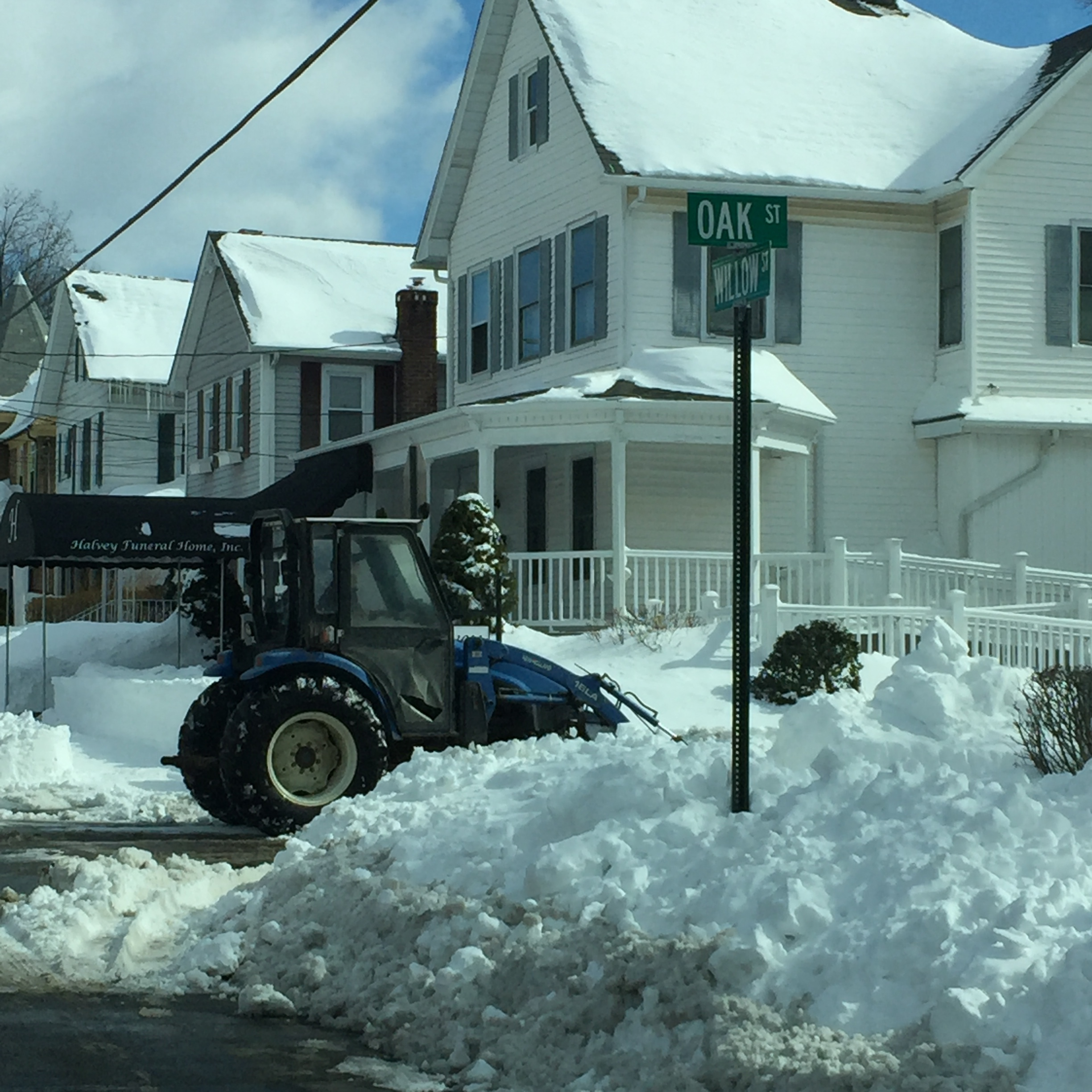 HaLvey Funeral Home completely cleared its sidewalks and street parking with a bulldozer.