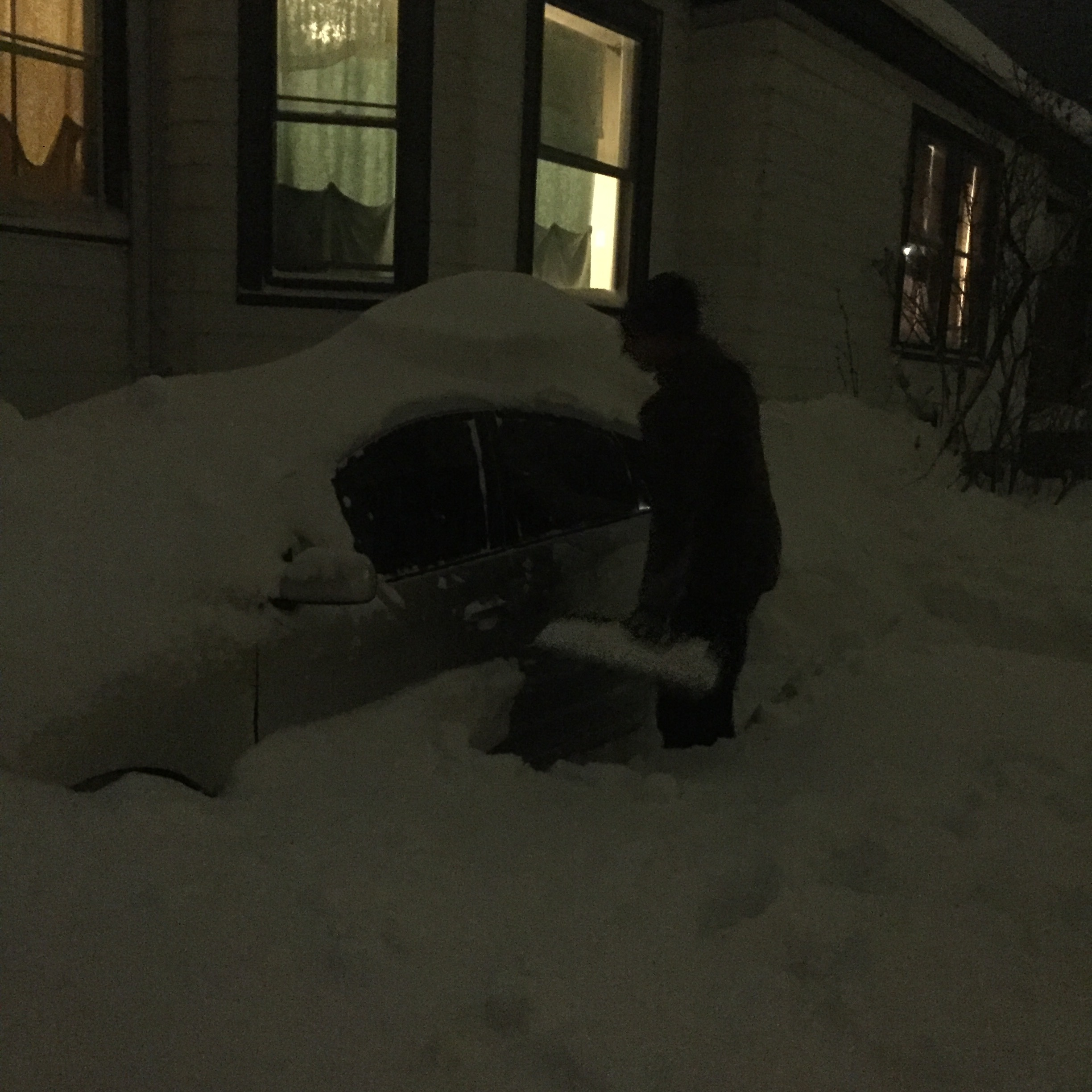 A man with no driveway borrows a neighbor's before heading to a public lot to shovel out two cars.
